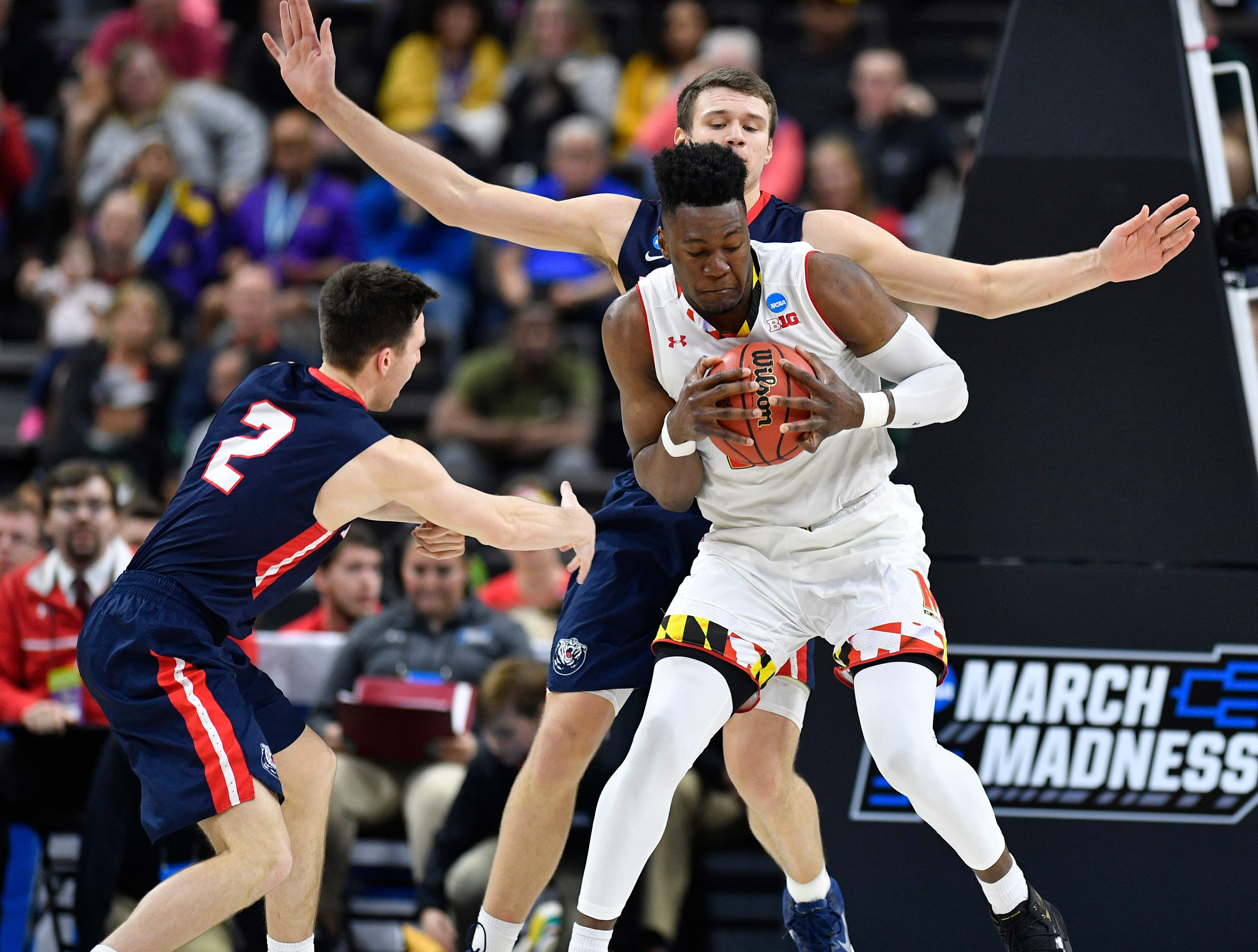 Belmont center Nick Muszynski (33) and guard Grayson Murphy (2) defend Maryland forward Bruno Fernando (23) during the second half of the first-round NCAA college basketball tournament game at VyStar Veterans Memorial Arena in Jacksonville, Fla., Thursday, March 21, 2019.