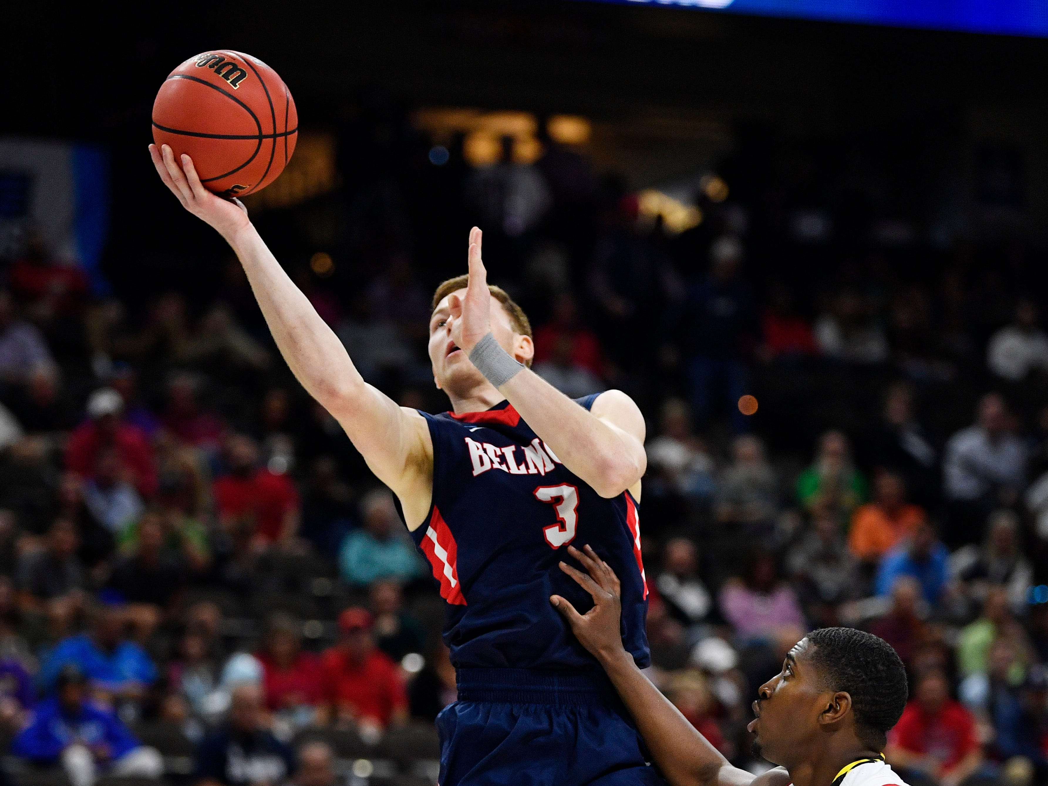 Belmont guard/forward Dylan Windler (3) goes to the basket defended by Maryland guard Darryl Morsell (11) during the first half of the first-round NCAA college basketball tournament game at VyStar Veterans Memorial Arena in Jacksonville, Fla., Thursday, March 21, 2019.