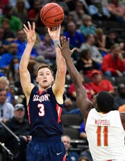Belmont guard/forward Dylan Windler (3) shoots over Maryland guard Darryl Morsell (11) during the first half of the first-round NCAA college basketball tournament game at VyStar Veterans Memorial Arena in Jacksonville, Fla., Thursday, March 21, 2019.