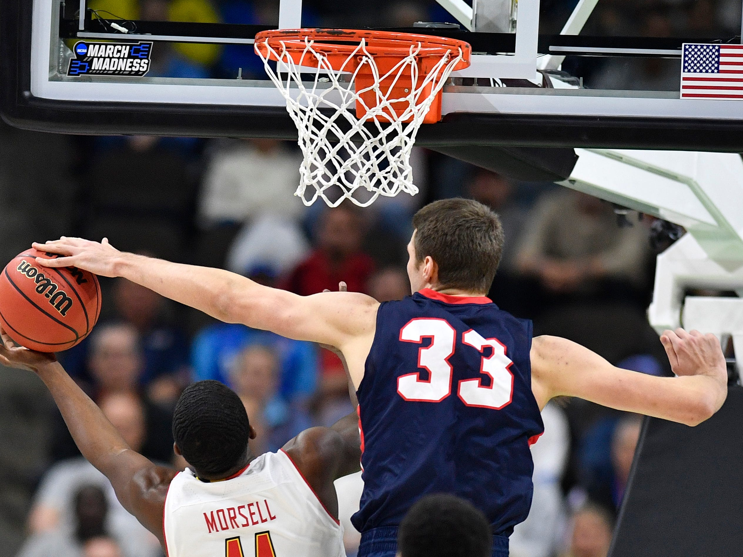 Belmont center Nick Muszynski (33) defends Maryland guard Darryl Morsell (11) but was called for a foul during the first half of the first-round NCAA college basketball tournament game at VyStar Veterans Memorial Arena in Jacksonville, Fla., Thursday, March 21, 2019.