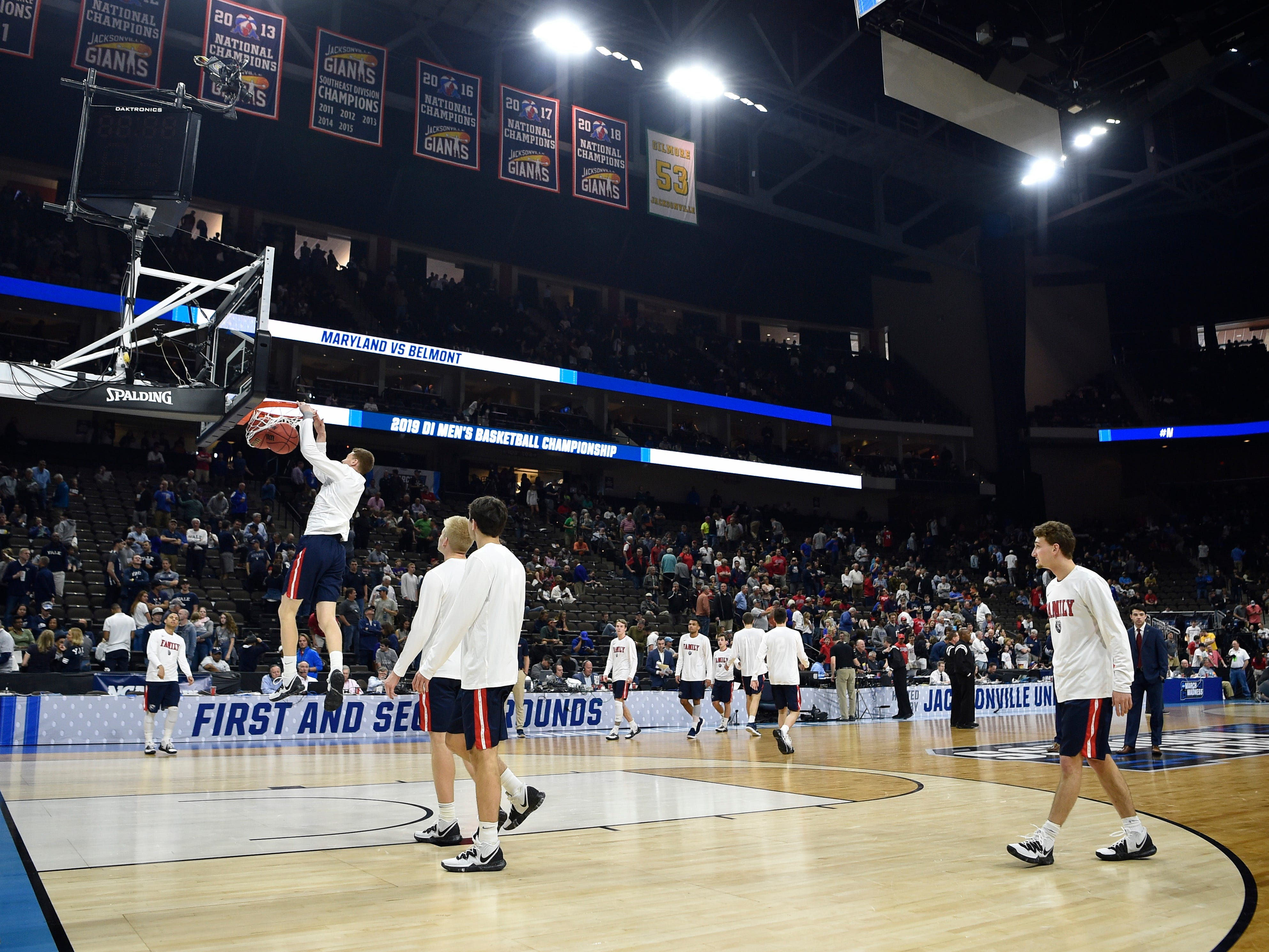 Belmont players warm up before the start of the first-round NCAA college basketball tournament game against Maryland at VyStar Veterans Memorial Arena in Jacksonville, Fla., Thursday, March 21, 2019.
