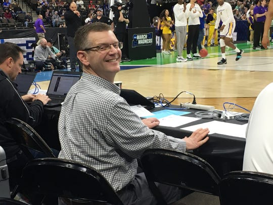 Belmont radio broadcaster Kevin Ingram could not get out of LSU's Emmitt Williams' way during the Tigers game against Yale.