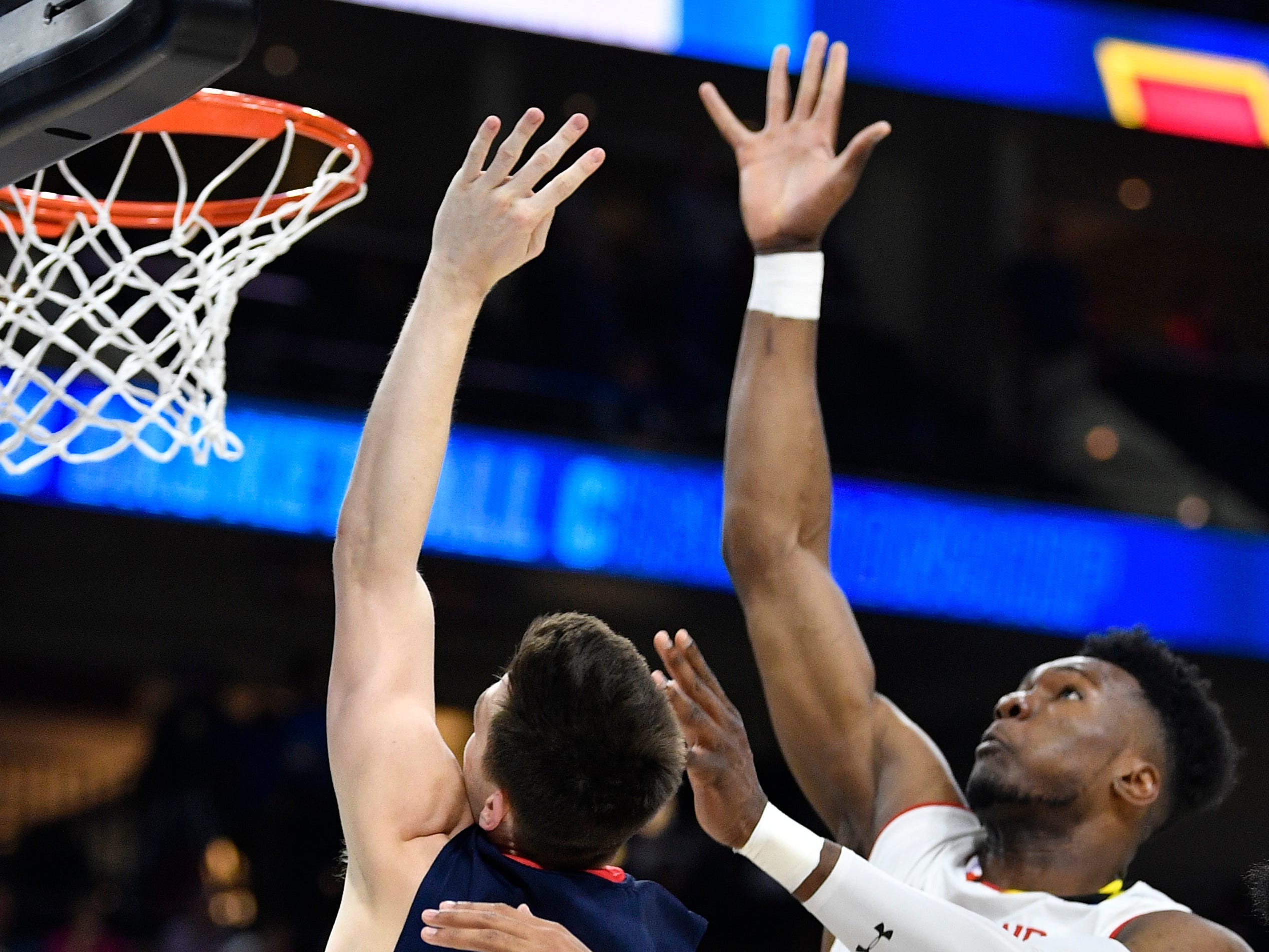 Belmont guard Grayson Murphy (2) and Maryland forward Bruno Fernando (23) battle under the basket during the first half of the first-round NCAA college basketball tournament game at VyStar Veterans Memorial Arena in Jacksonville, Fla., Thursday, March 21, 2019.