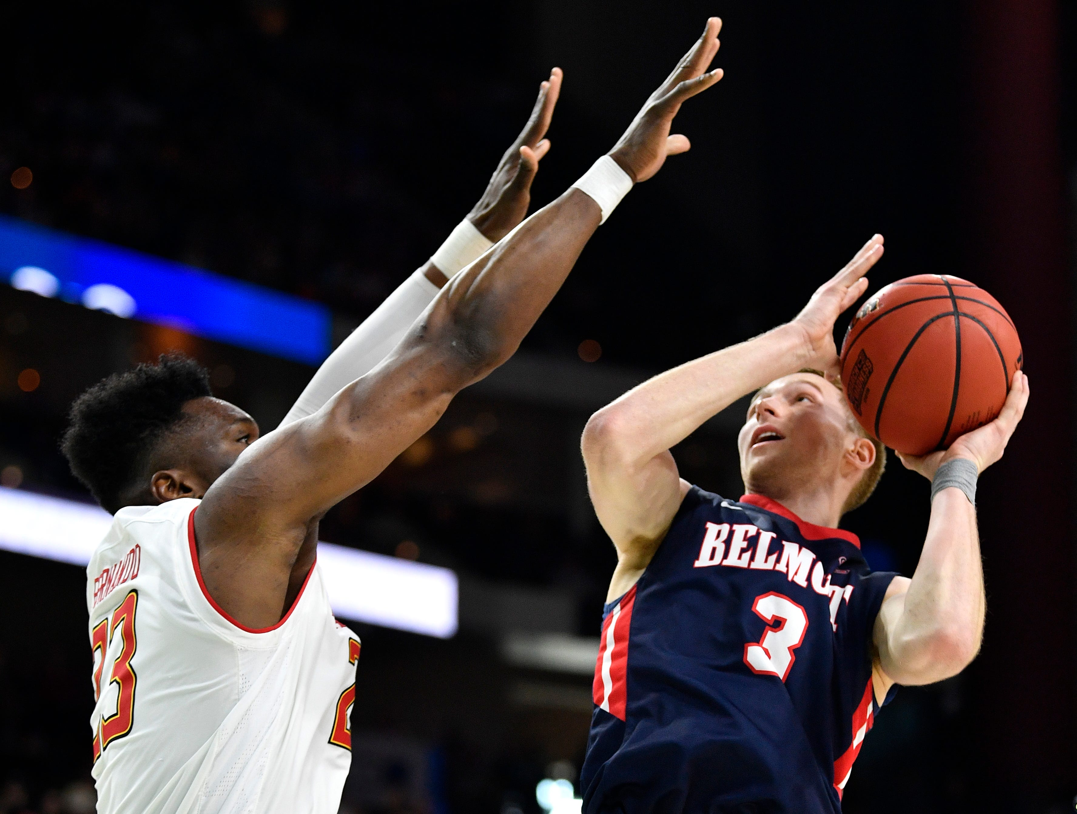 Belmont guard/forward Dylan Windler (3) shoots against Maryland forward Bruno Fernando (23) during the second half of the first-round NCAA college basketball tournament game at VyStar Veterans Memorial Arena in Jacksonville, Fla., Thursday, March 21, 2019.