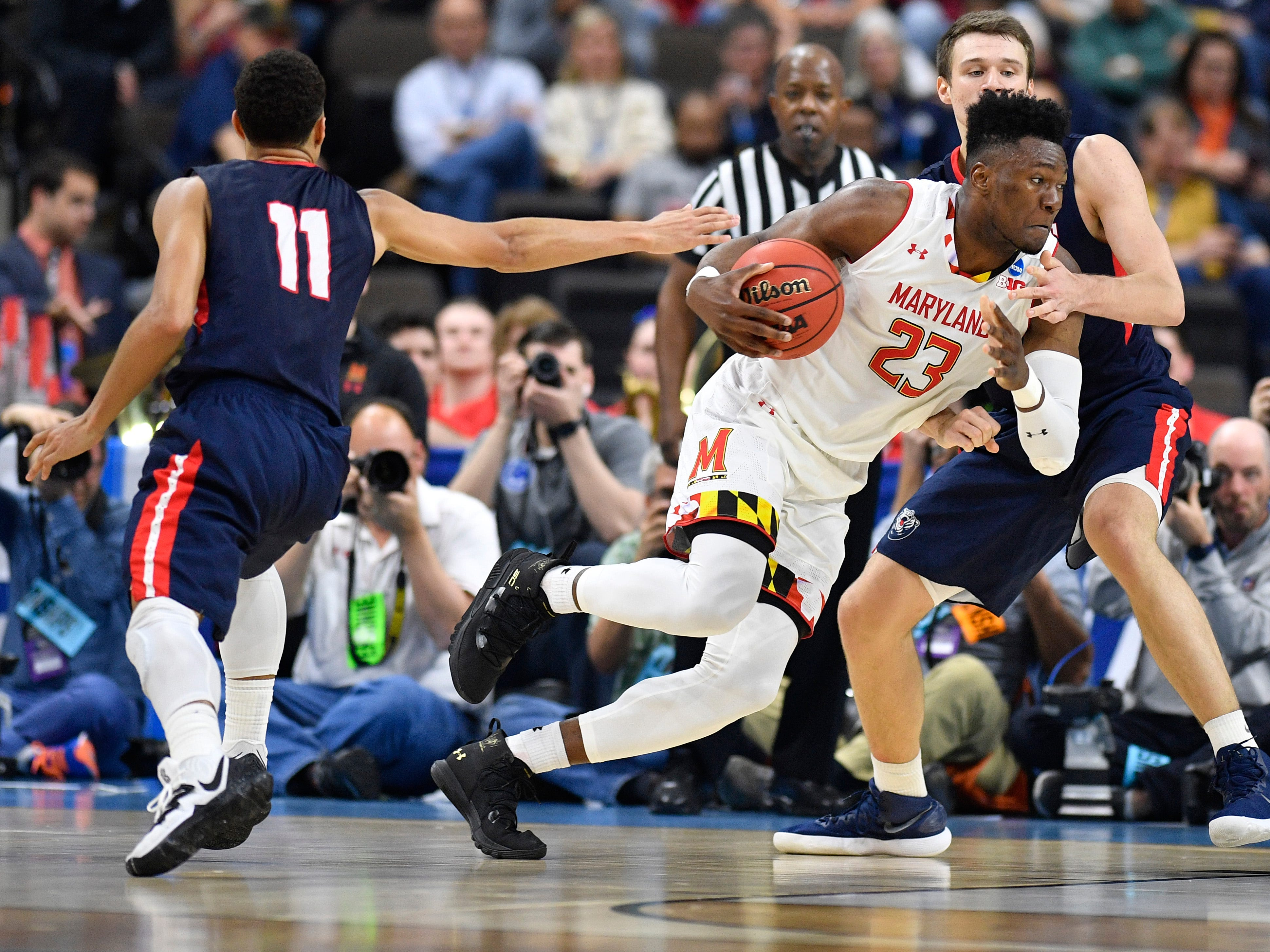 Maryland forward Bruno Fernando (23) pushes past Belmont center Seth Adelsperger (50) during the first half of the first-round NCAA college basketball tournament game at VyStar Veterans Memorial Arena in Jacksonville, Fla., Thursday, March 21, 2019.