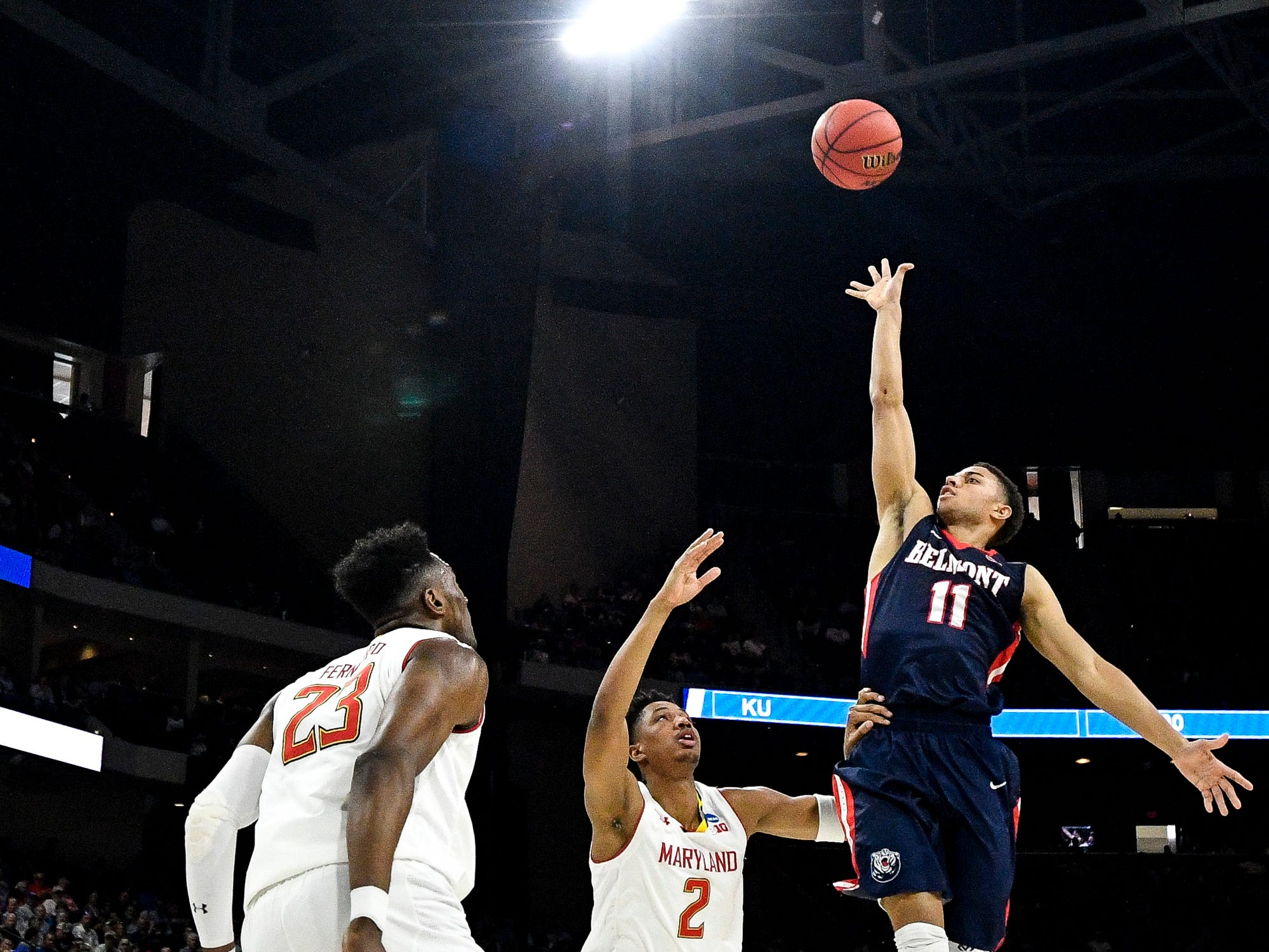Belmont guard Kevin McClain (11) shoots past Maryland guard Aaron Wiggins (2) during the first half of the first-round NCAA college basketball tournament game at VyStar Veterans Memorial Arena in Jacksonville, Fla., Thursday, March 21, 2019.