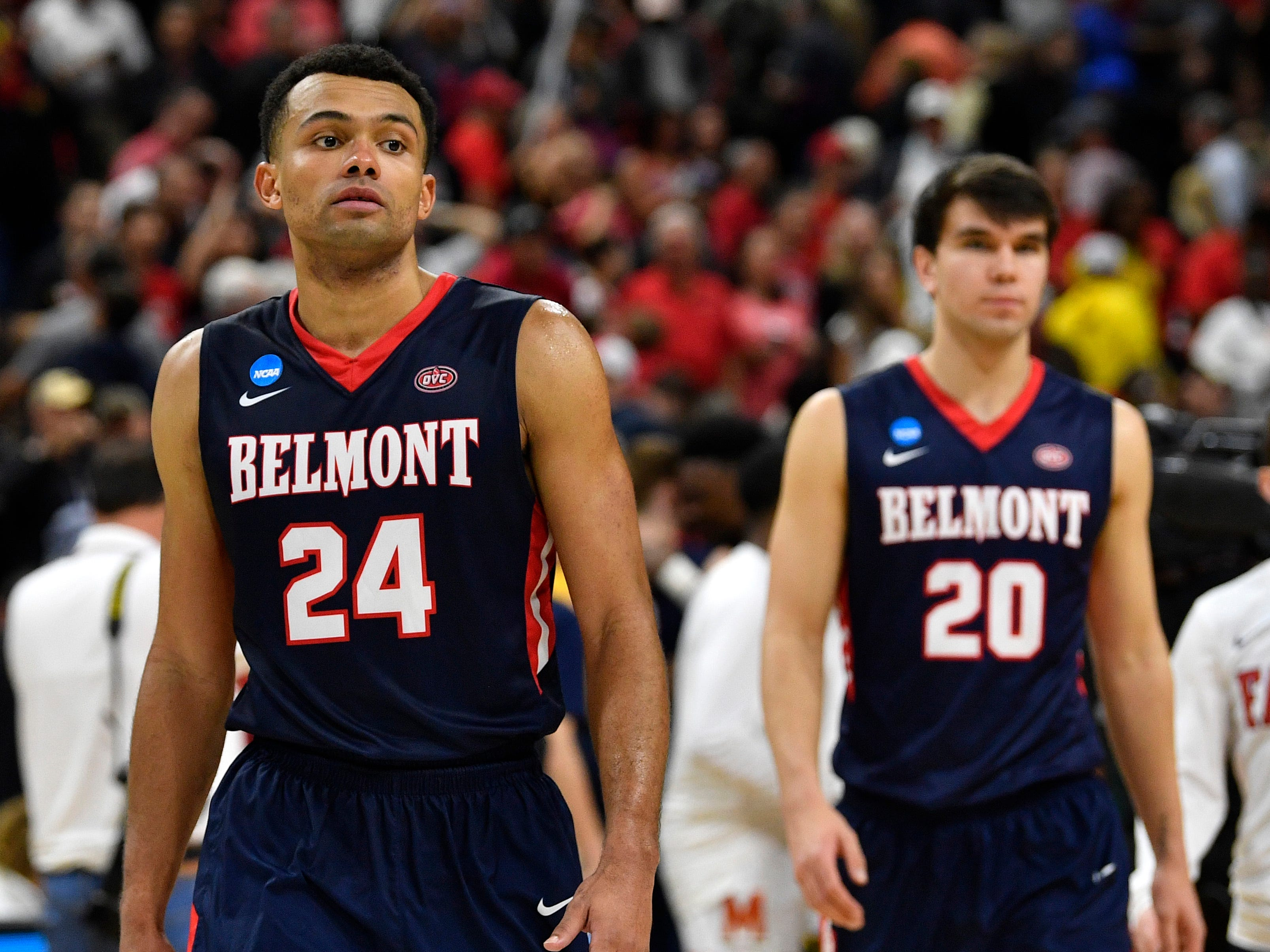 Belmont guards Michael Benkert (24) and Tate Pierson (20) react after the loss to Maryland in their first-round NCAA college basketball tournament game at VyStar Veterans Memorial Arena in Jacksonville, Fla., Thursday, March 21, 2019.