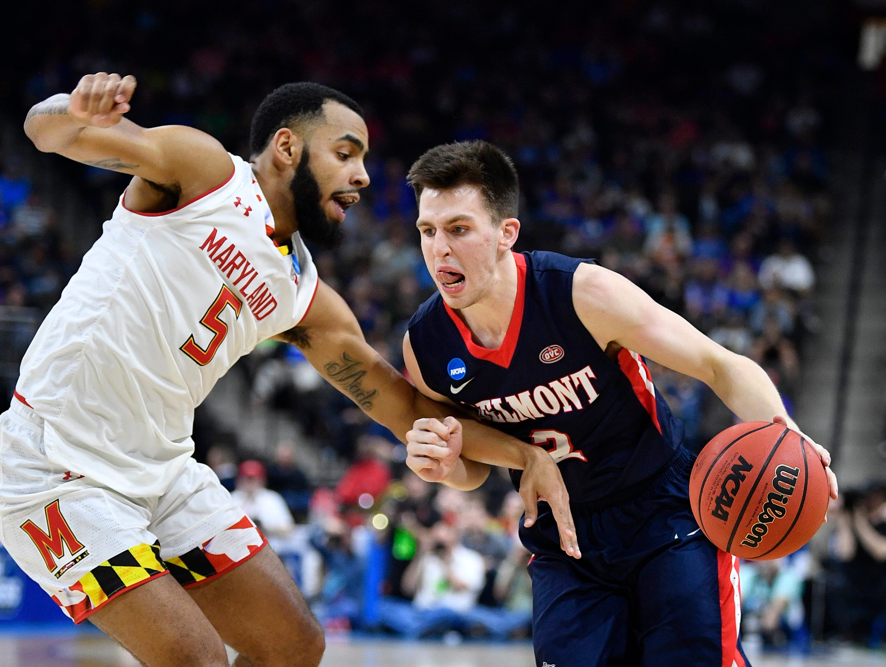 Belmont guard Grayson Murphy (2) moves the ball defended by Maryland guard Eric Ayala (5) during the first half of the first-round NCAA college basketball tournament game at VyStar Veterans Memorial Arena in Jacksonville, Fla., Thursday, March 21, 2019.