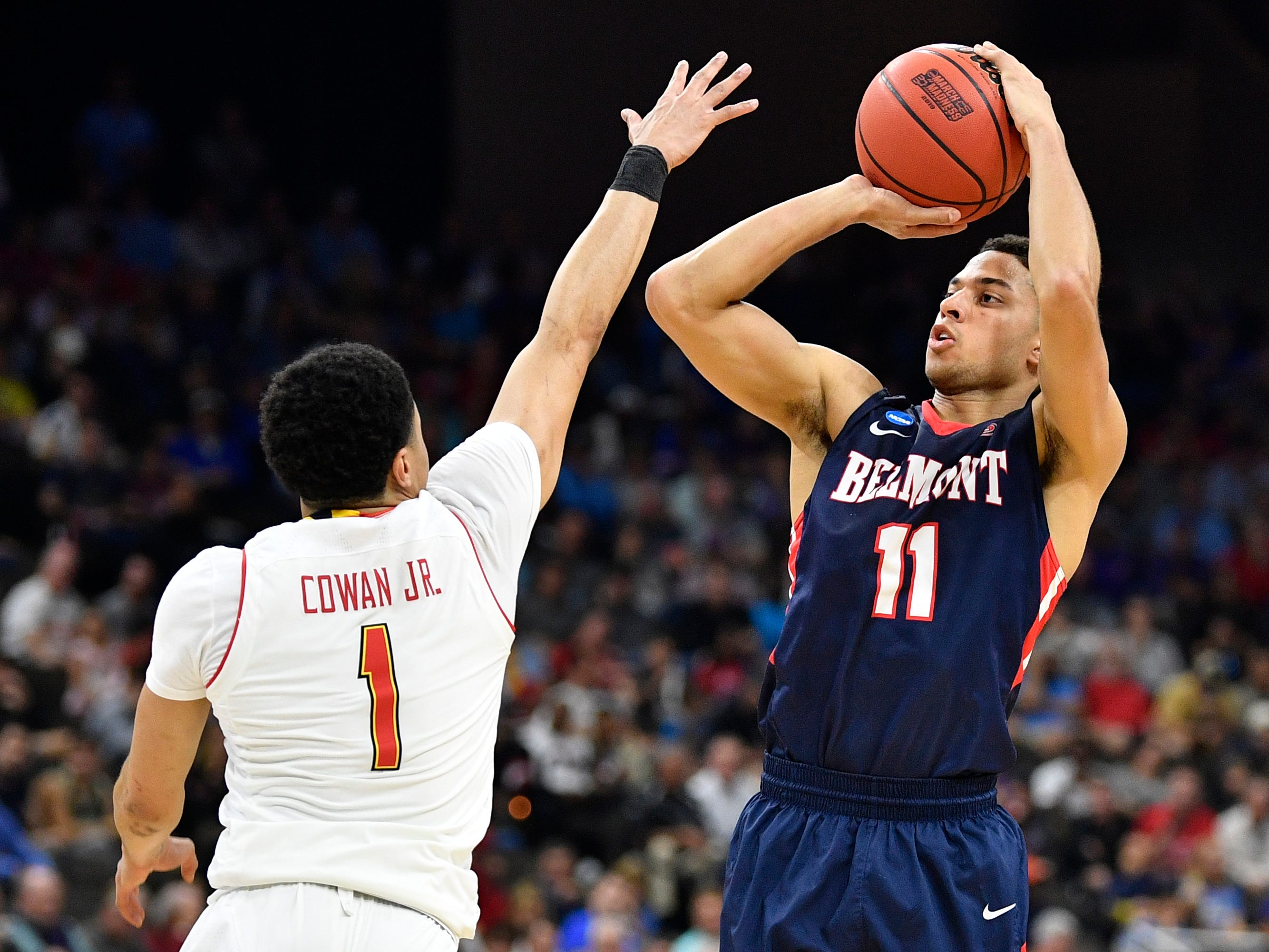 Belmont guard Kevin McClain (11) shoots over Maryland guard Anthony Cowan Jr. (1) during the first half of the first-round NCAA college basketball tournament game at VyStar Veterans Memorial Arena in Jacksonville, Fla., Thursday, March 21, 2019.