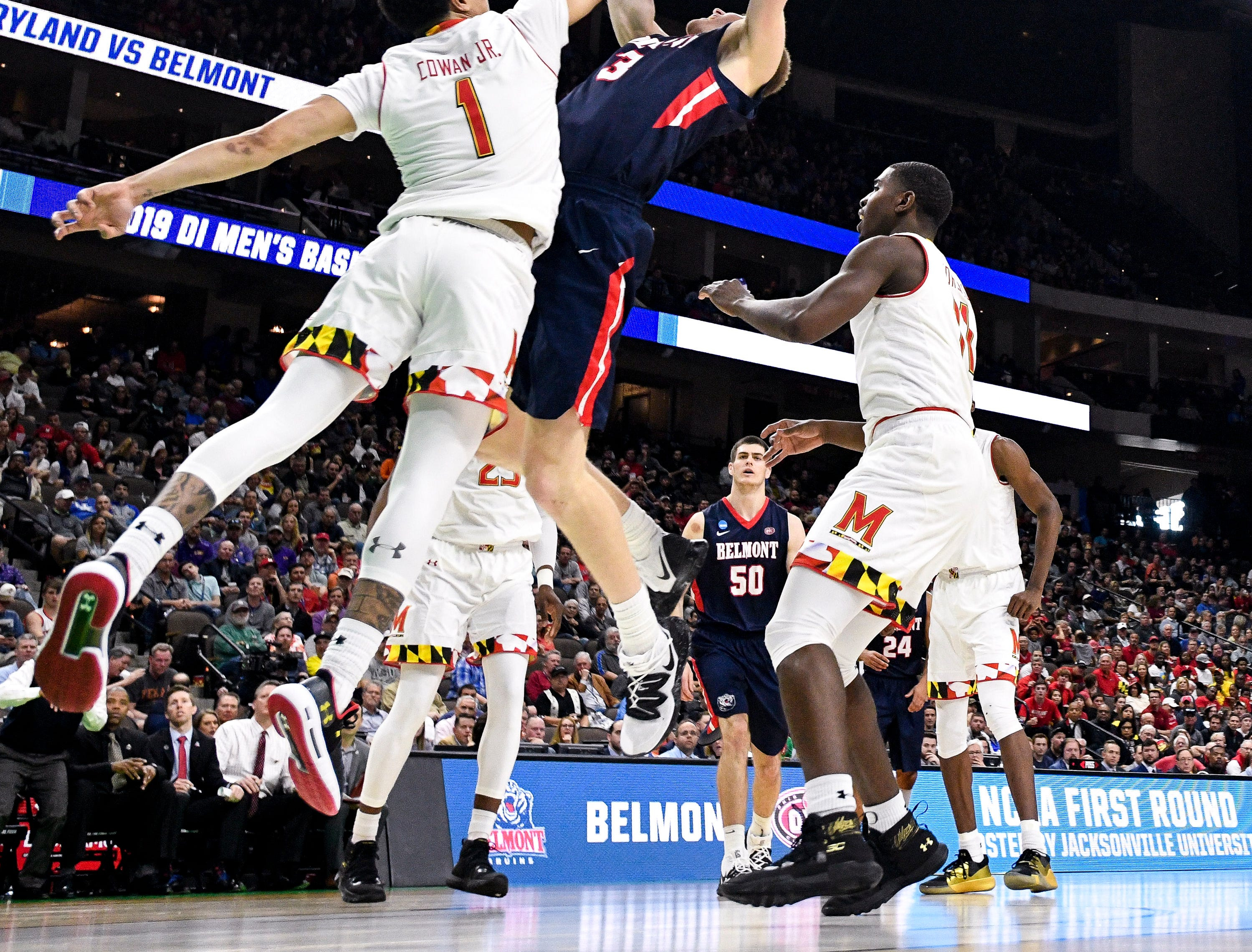 Maryland guard Anthony Cowan Jr. (1) defends against Belmont guard/forward Dylan Windler (3) during the second half of the first-round NCAA college basketball tournament game at VyStar Veterans Memorial Arena in Jacksonville, Fla., Thursday, March 21, 2019.
