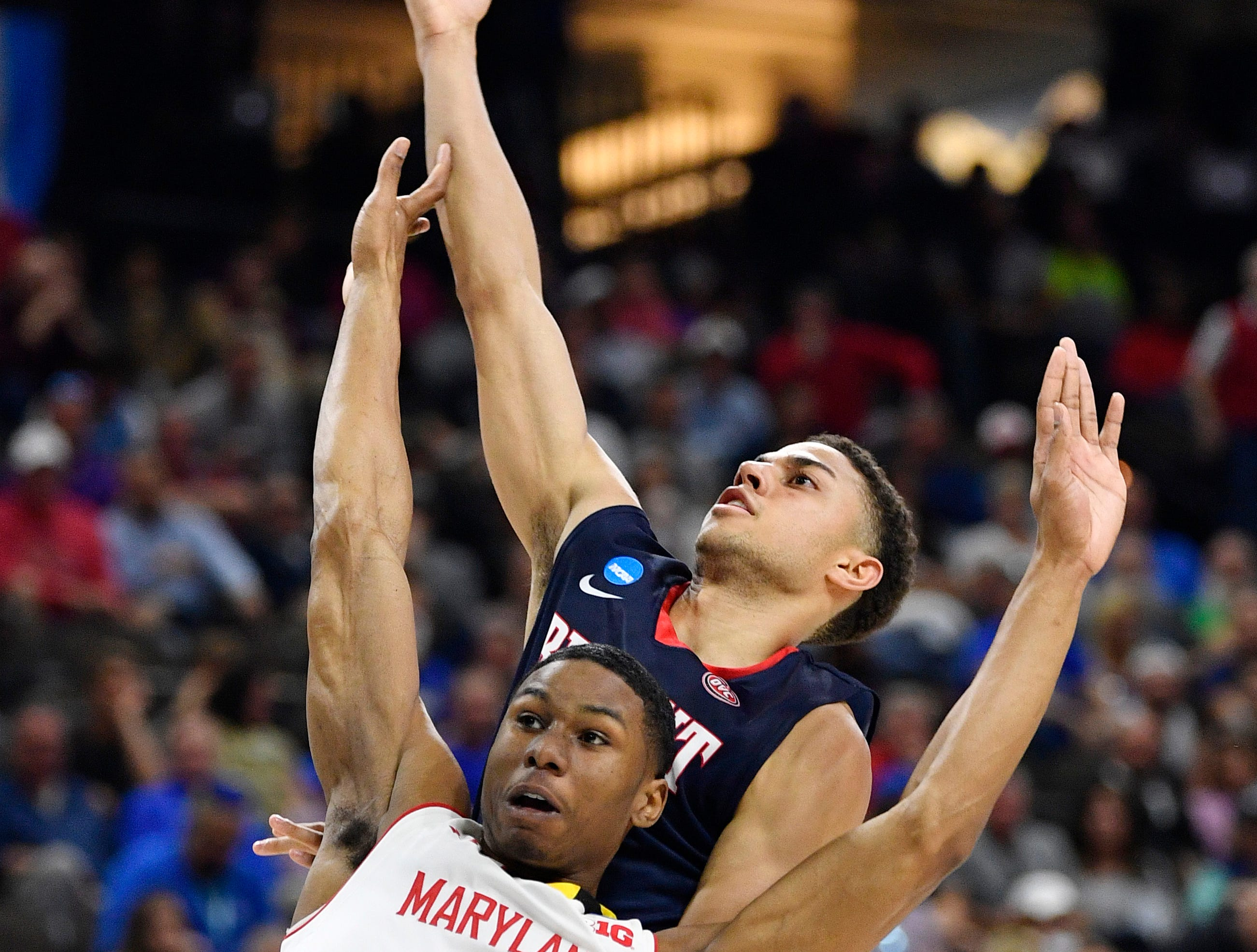 Belmont guard Kevin McClain (11) shoots over Maryland guard Serrel Smith Jr. (10) during the first half of the first-round NCAA college basketball tournament game at VyStar Veterans Memorial Arena in Jacksonville, Fla., Thursday, March 21, 2019.