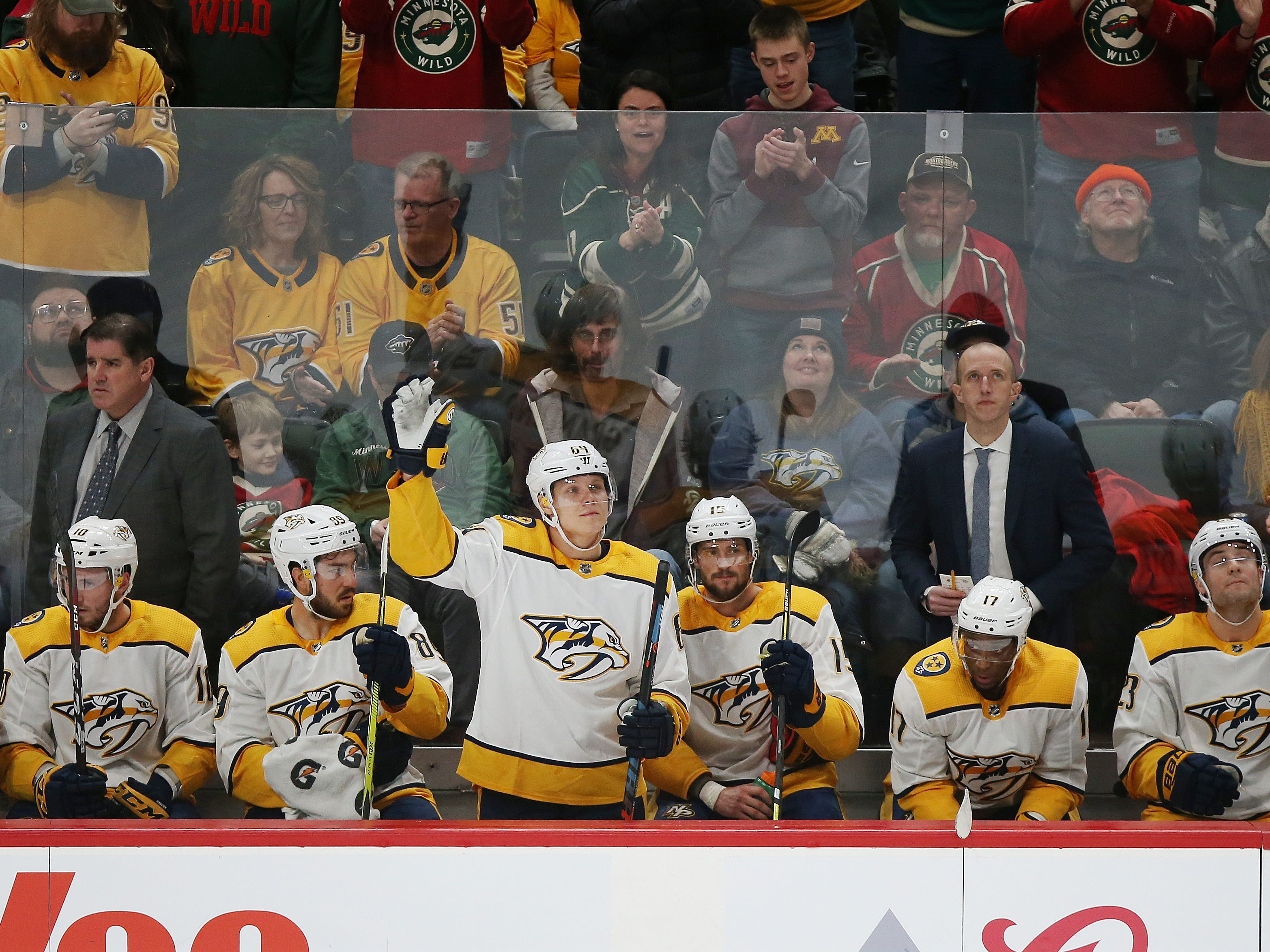 Nashville Predators' Mikael Granlund waves to fans after returning to the ice to play against his former team the Minnesota Wild on March 3, 2019.