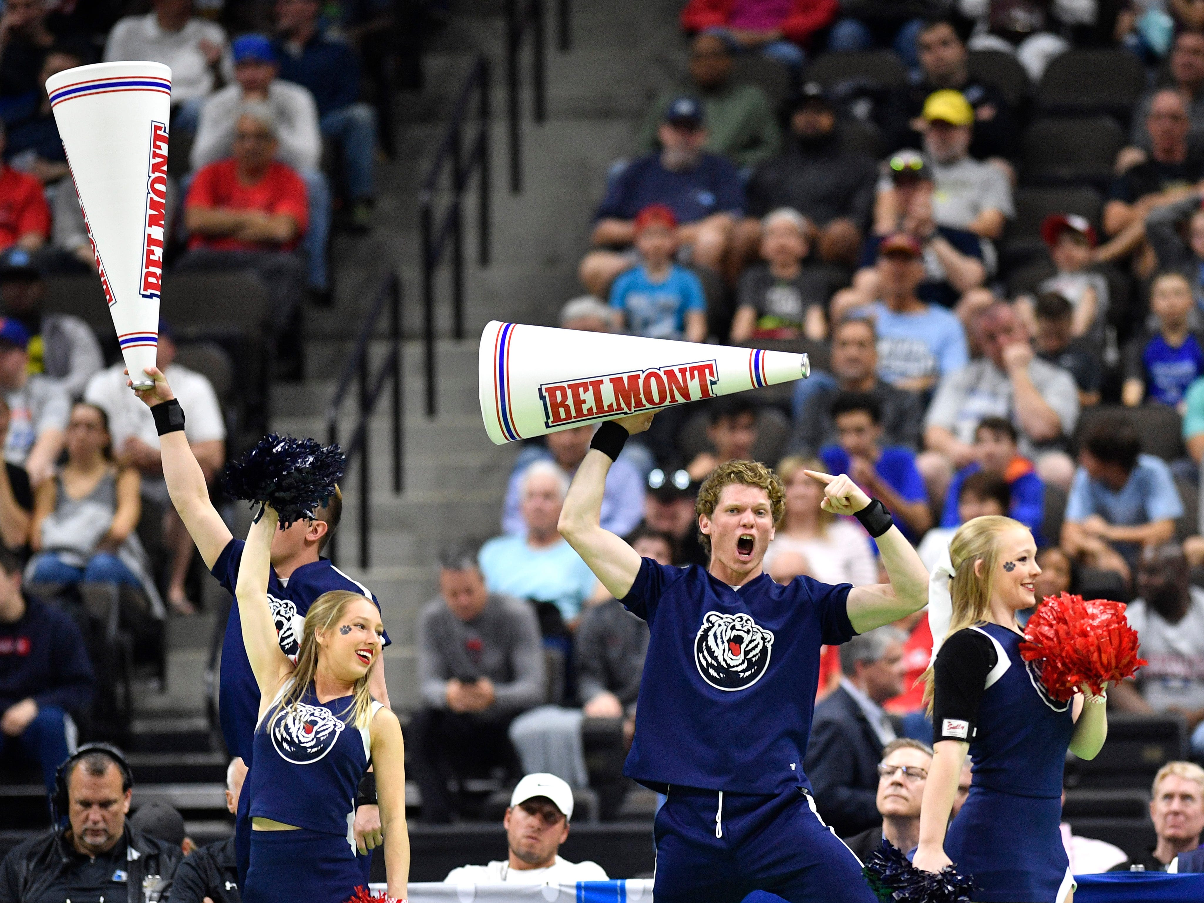 Belmont cheerleaders lead the fans during the first half of the first-round NCAA college basketball tournament game at VyStar Veterans Memorial Arena in Jacksonville, Fla., Thursday, March 21, 2019.