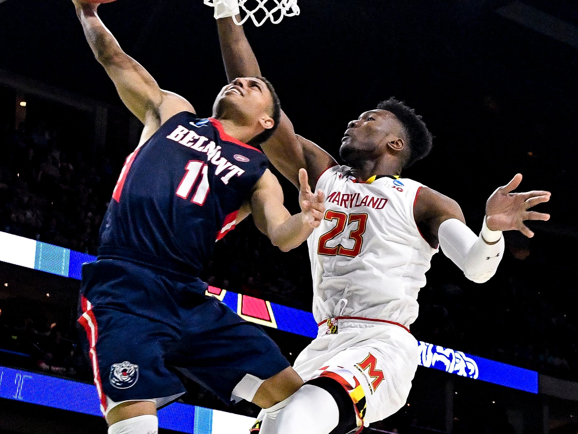Belmont guard Kevin McClain (11) shoots against Maryland forward Bruno Fernando (23) during the second half of the first-round NCAA college basketball tournament game at VyStar Veterans Memorial Arena in Jacksonville, Fla., Thursday, March 21, 2019.