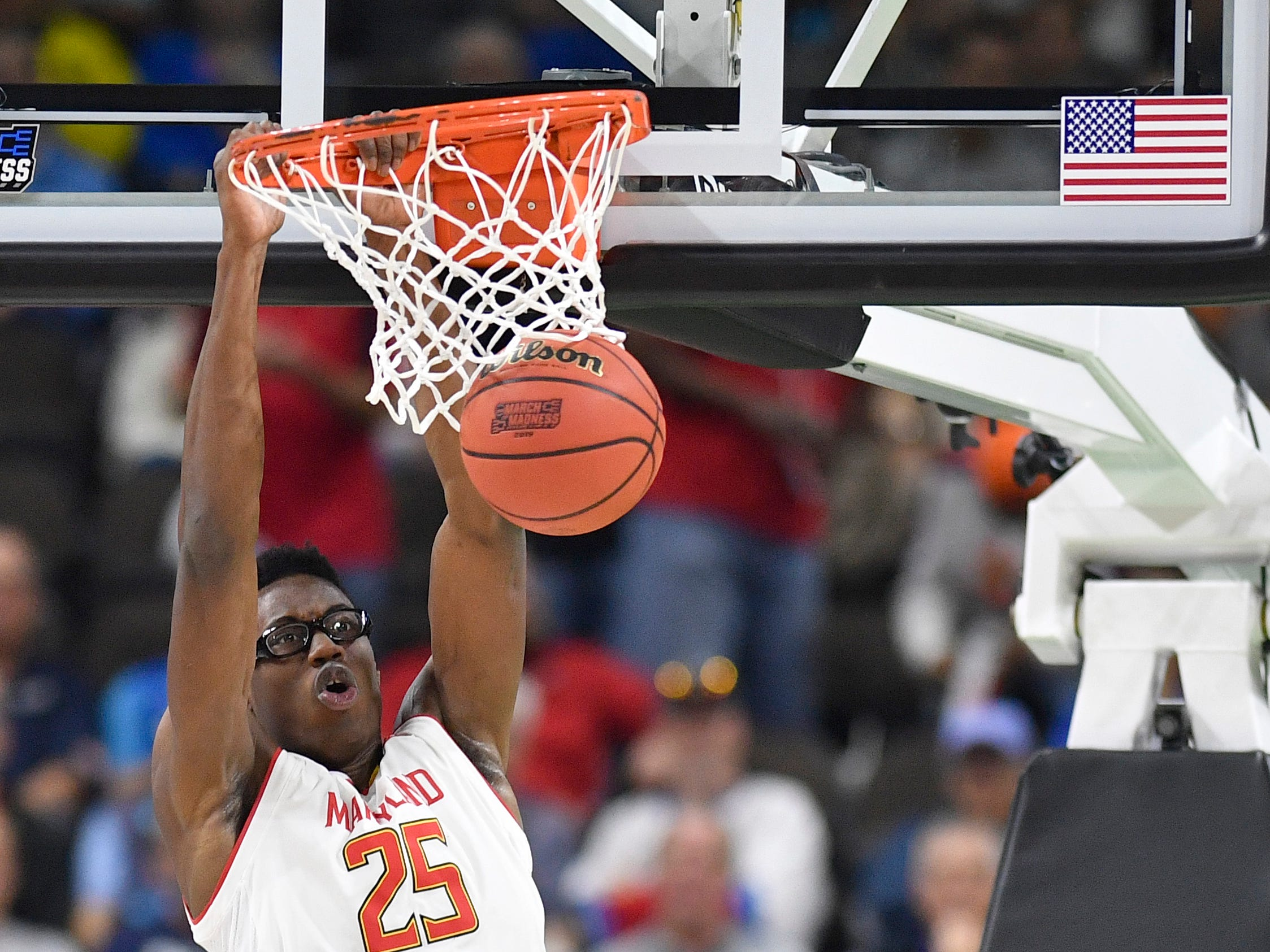Maryland forward Jalen Smith (25) dunks during the first half of the first-round NCAA college basketball tournament game against Belmont at VyStar Veterans Memorial Arena in Jacksonville, Fla., Thursday, March 21, 2019.