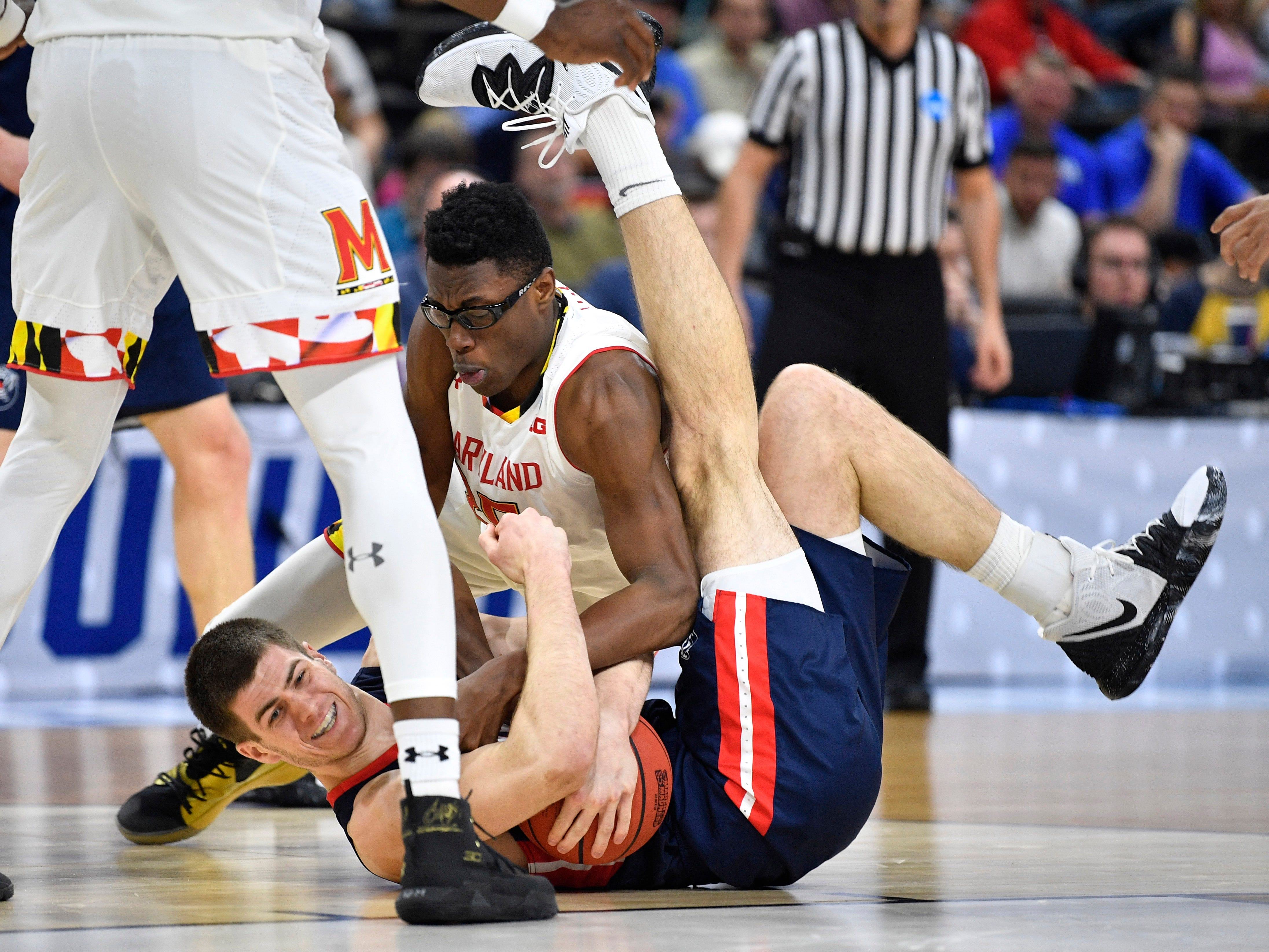 Belmont center Seth Adelsperger (50) and Maryland forward Jalen Smith (25) battle for the ball during the first half of the first-round NCAA college basketball tournament game at VyStar Veterans Memorial Arena in Jacksonville, Fla., Thursday, March 21, 2019.