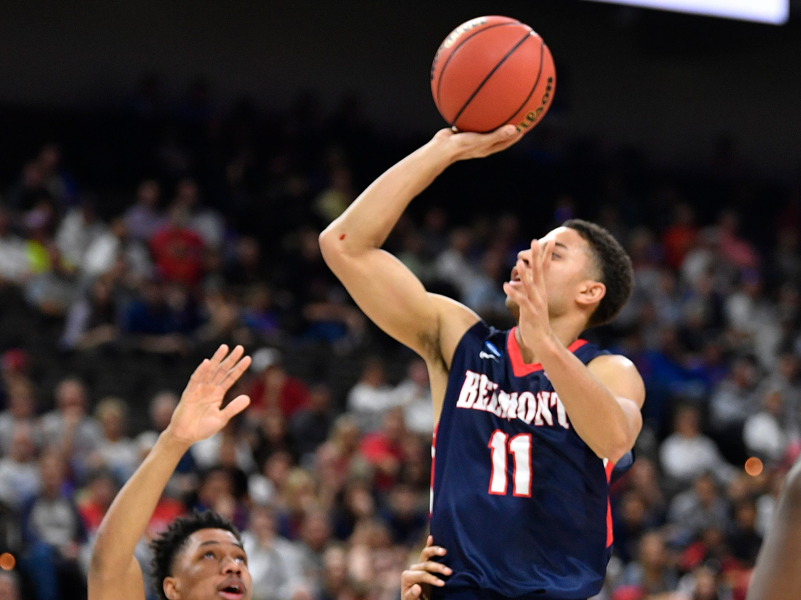 Belmont guard Kevin McClain (11) shoots over Maryland guard Aaron Wiggins (2) during the first half of the first-round NCAA college basketball tournament game at VyStar Veterans Memorial Arena in Jacksonville, Fla., Thursday, March 21, 2019.