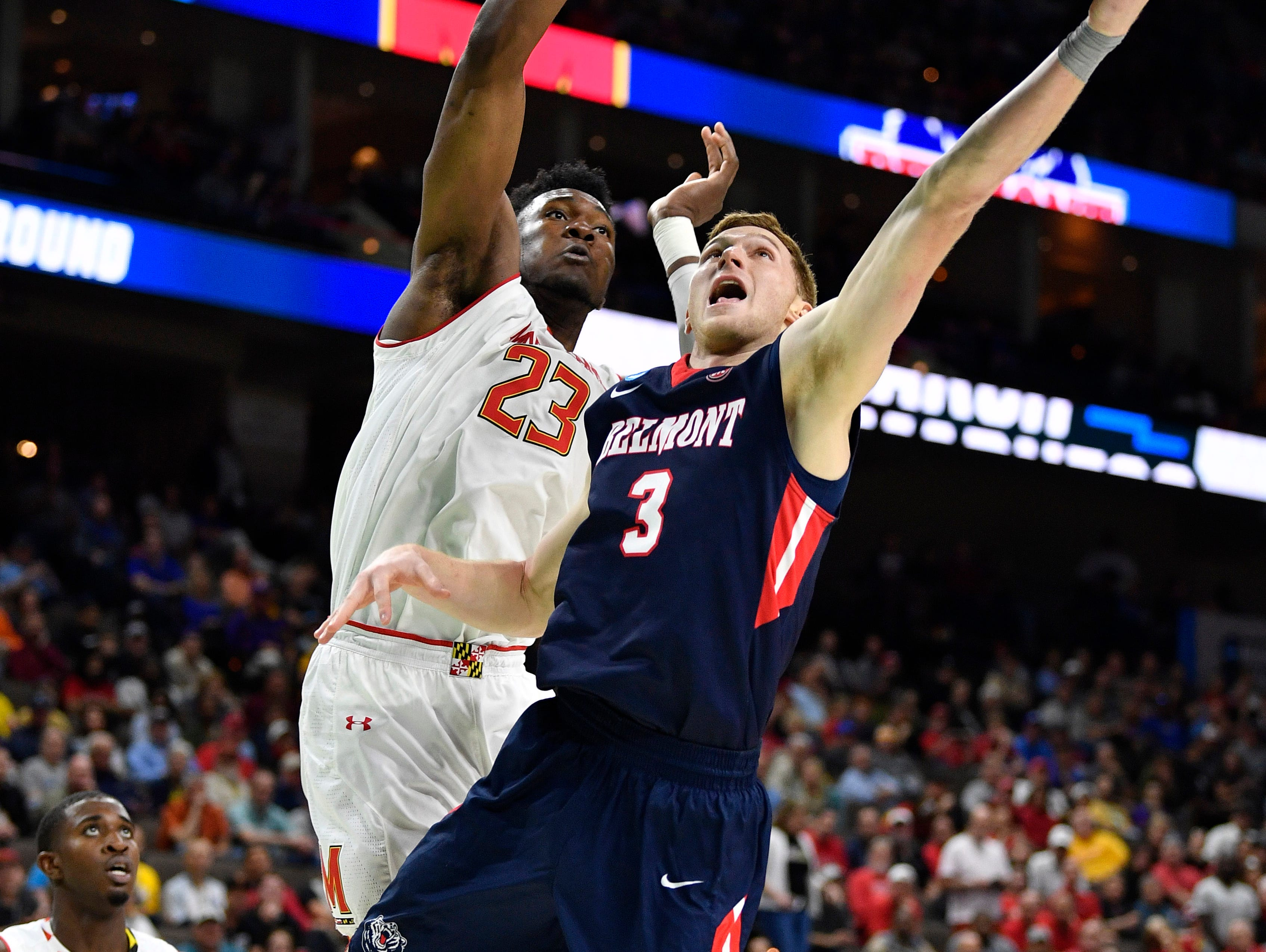 Belmont guard/forward Dylan Windler (3) scores defended by Maryland forward Bruno Fernando (23) during the second half of the first-round NCAA college basketball tournament game at VyStar Veterans Memorial Arena in Jacksonville, Fla., Thursday, March 21, 2019.
