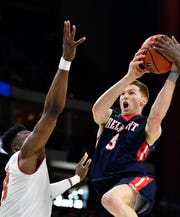 Belmont guard/forward Dylan Windler (3) drives to the basket during the second half of the first-round NCAA college basketball tournament game at VyStar Veterans Memorial Arena in Jacksonville, Fla., Thursday, March 21, 2019.