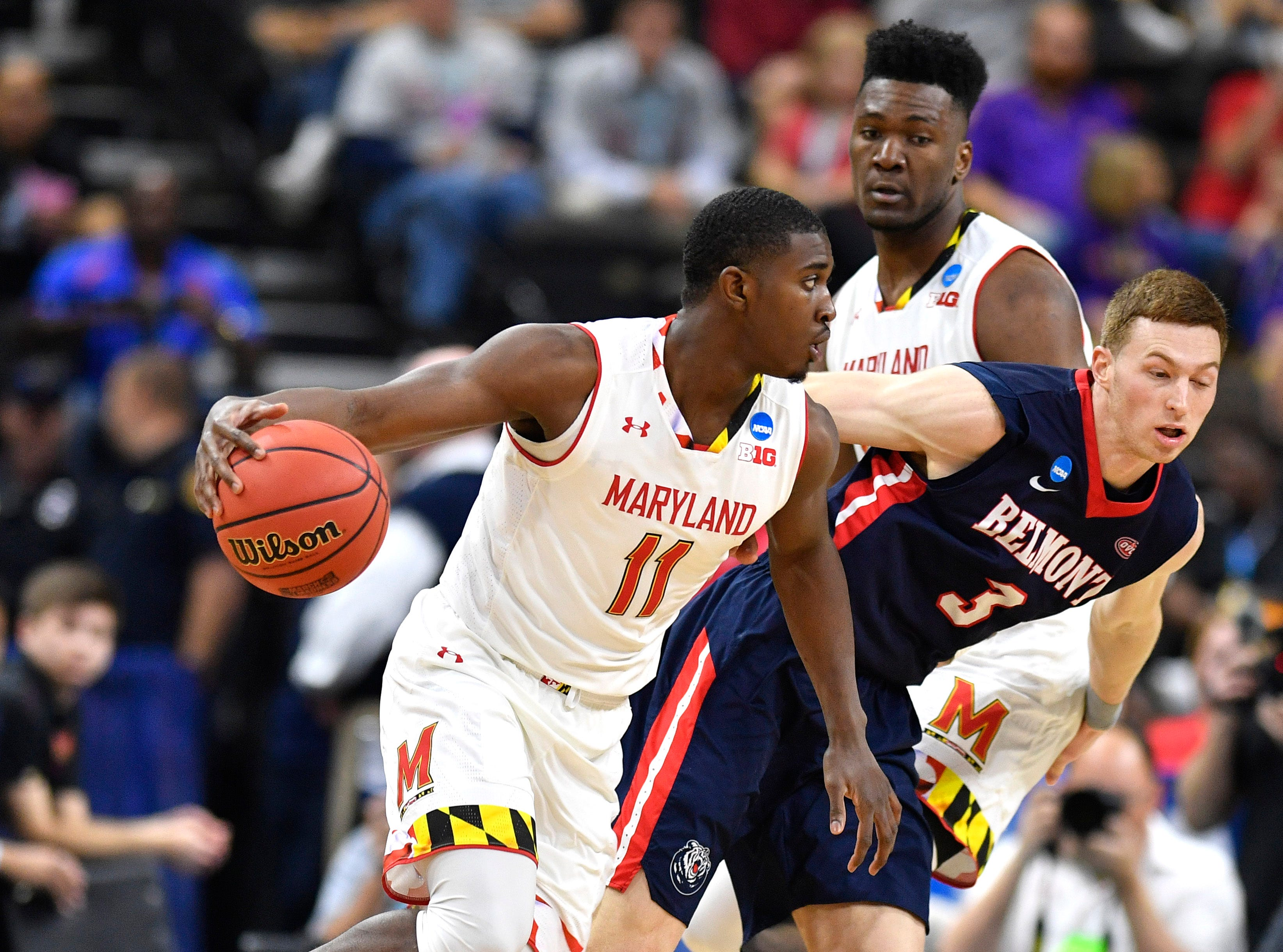 Maryland guard Darryl Morsell (11) moves the ball defended by Belmont guard/forward Dylan Windler (3) during the second half of the first-round NCAA college basketball tournament game at VyStar Veterans Memorial Arena in Jacksonville, Fla., Thursday, March 21, 2019.