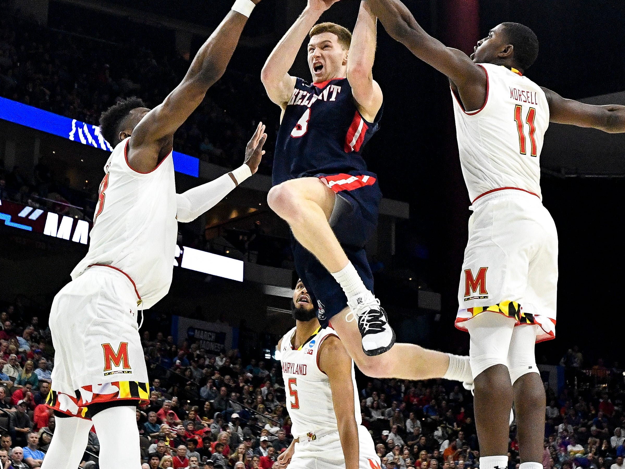 Belmont guard/forward Dylan Windler (3) is fouled by Maryland guard Darryl Morsell (11) during the second half of the first-round NCAA college basketball tournament game at VyStar Veterans Memorial Arena in Jacksonville, Fla., Thursday, March 21, 2019.