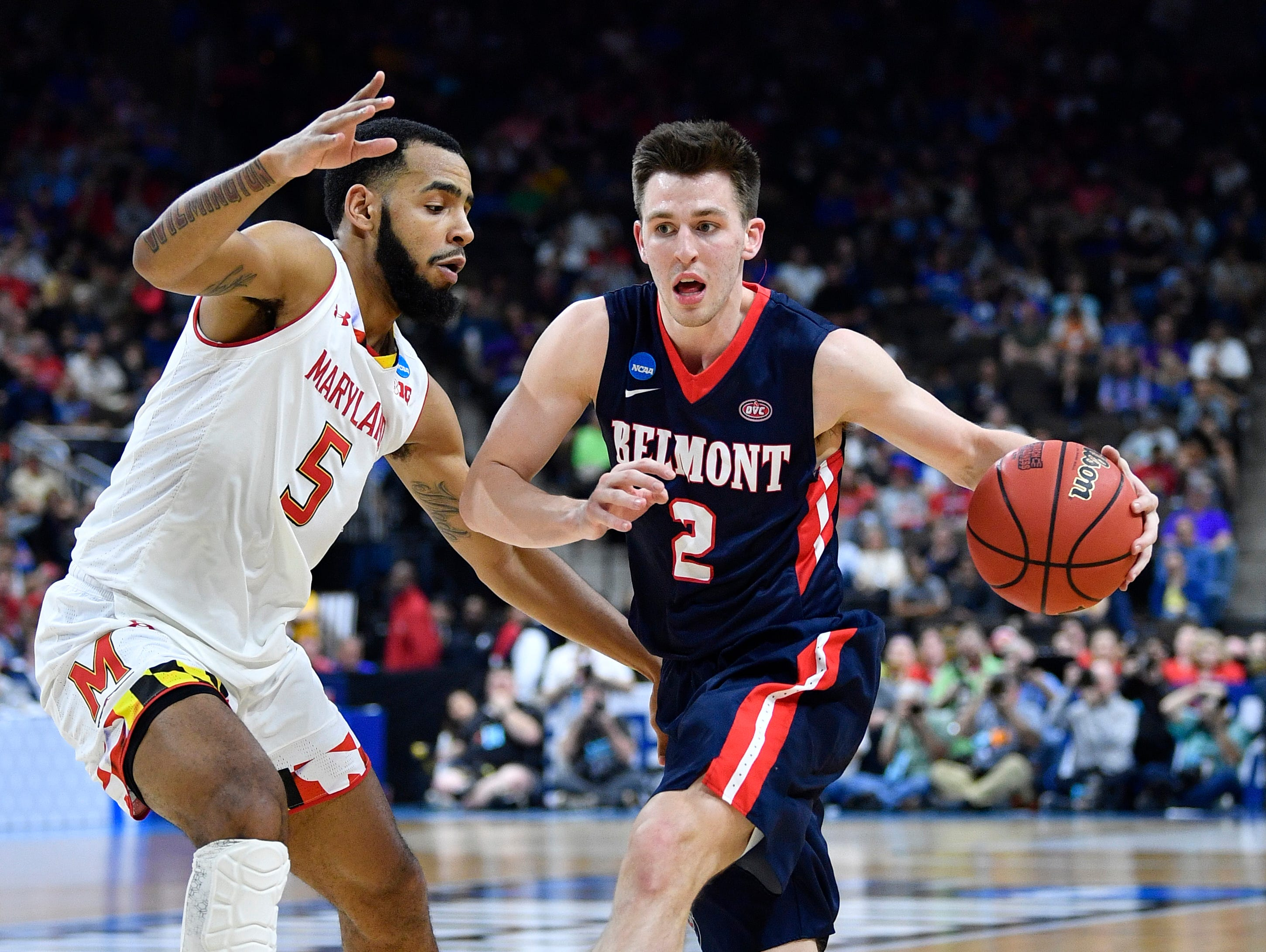 Belmont guard Grayson Murphy (2) drives past Maryland guard Eric Ayala (5) during the first half of the first-round NCAA college basketball tournament game at VyStar Veterans Memorial Arena in Jacksonville, Fla., Thursday, March 21, 2019.