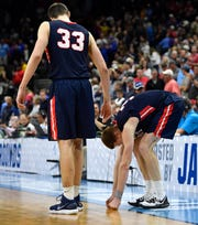 Belmont center Nick Muszynski (33) and guard/forward Dylan Windler (3) react after the loss to Maryland during in the first-round NCAA college basketball tournament game at VyStar Veterans Memorial Arena in Jacksonville, Fla., Thursday, March 21, 2019.