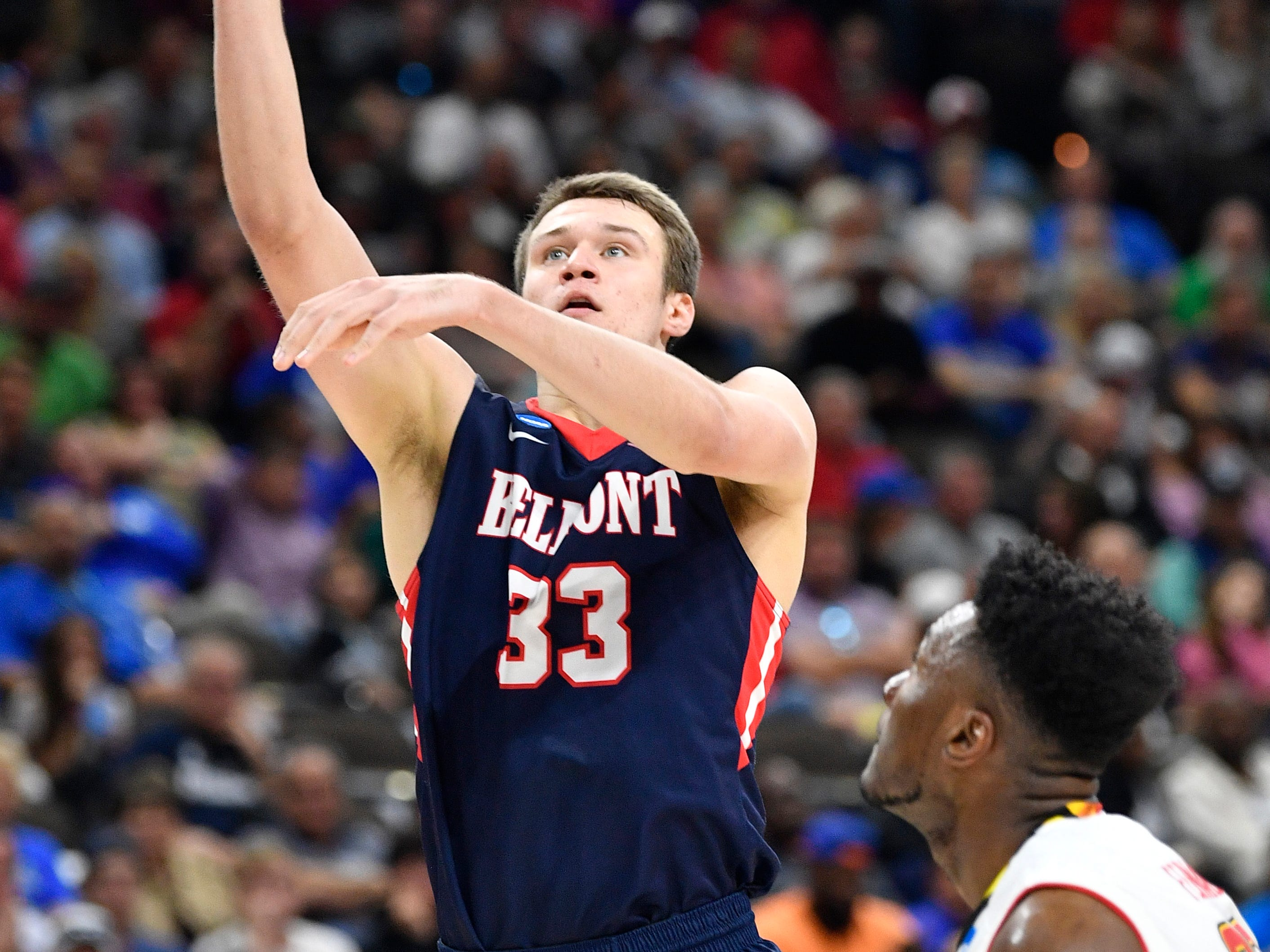 Belmont center Nick Muszynski (33) shoots against Maryland forward Bruno Fernando (23) during the first half of the first-round NCAA college basketball tournament game at VyStar Veterans Memorial Arena in Jacksonville, Fla., Thursday, March 21, 2019.