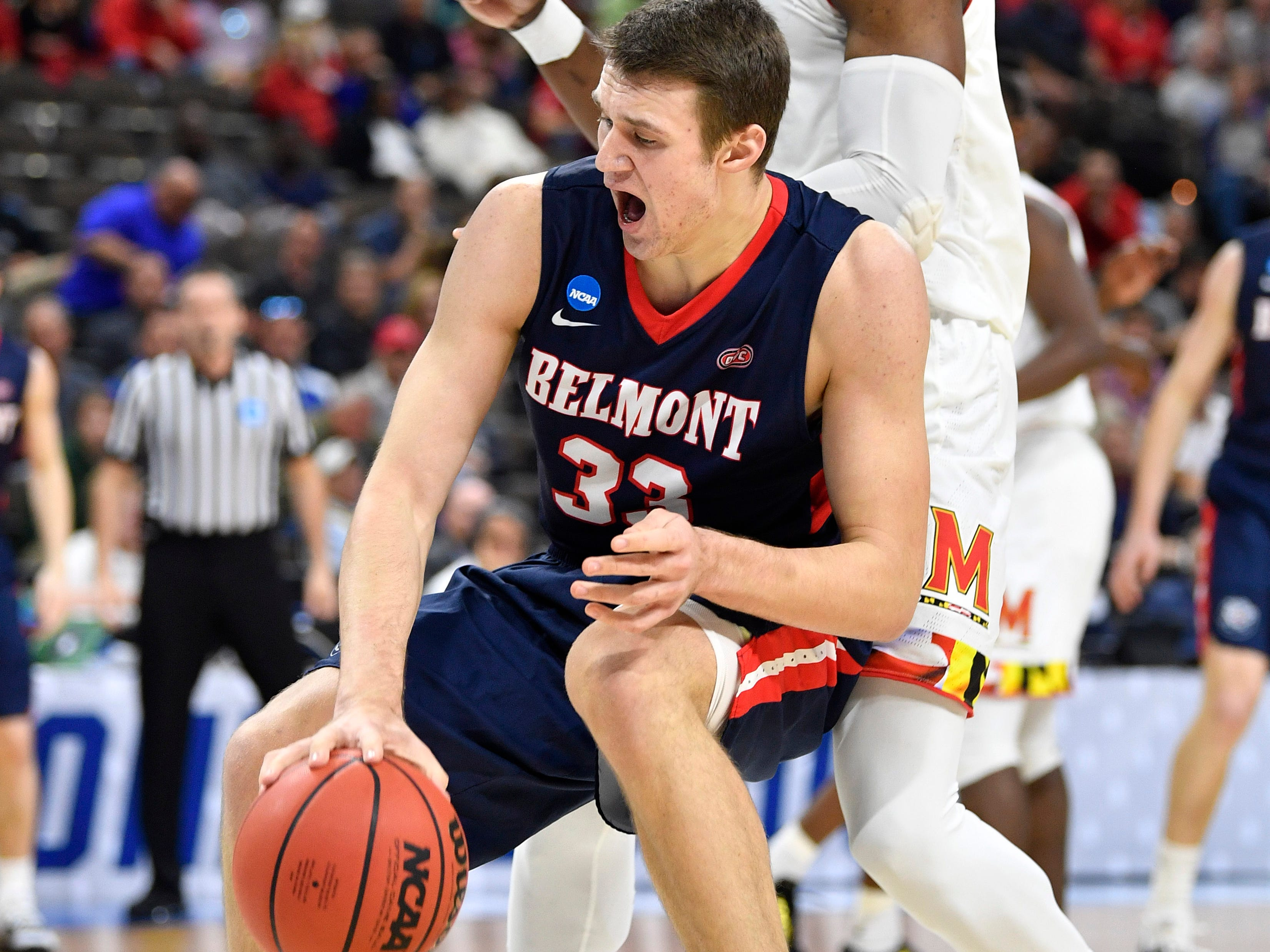 Belmont center Nick Muszynski (33) moves the ball defended by Maryland forward Bruno Fernando (23) during the first half of the first-round NCAA college basketball tournament game at VyStar Veterans Memorial Arena in Jacksonville, Fla., Thursday, March 21, 2019.