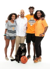 Tennessee associate head coach Rob Lanier with daughter Kai, son Emory, wife Dayo and dog Sandy.