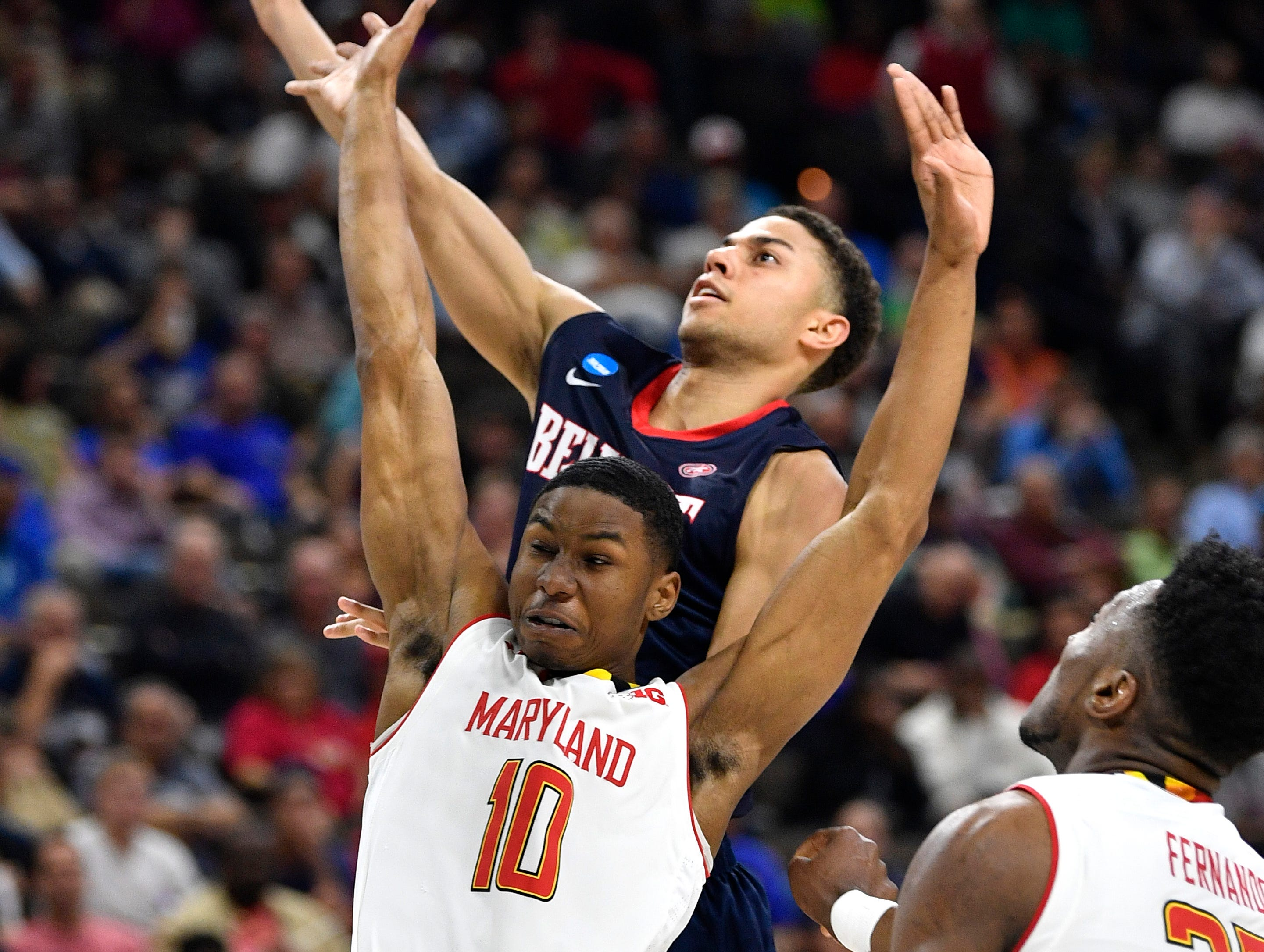 Belmont guard Kevin McClain (11) shoots past Maryland guard Serrel Smith Jr. (10) during the first half of the first-round NCAA college basketball tournament game at VyStar Veterans Memorial Arena in Jacksonville, Fla., Thursday, March 21, 2019.