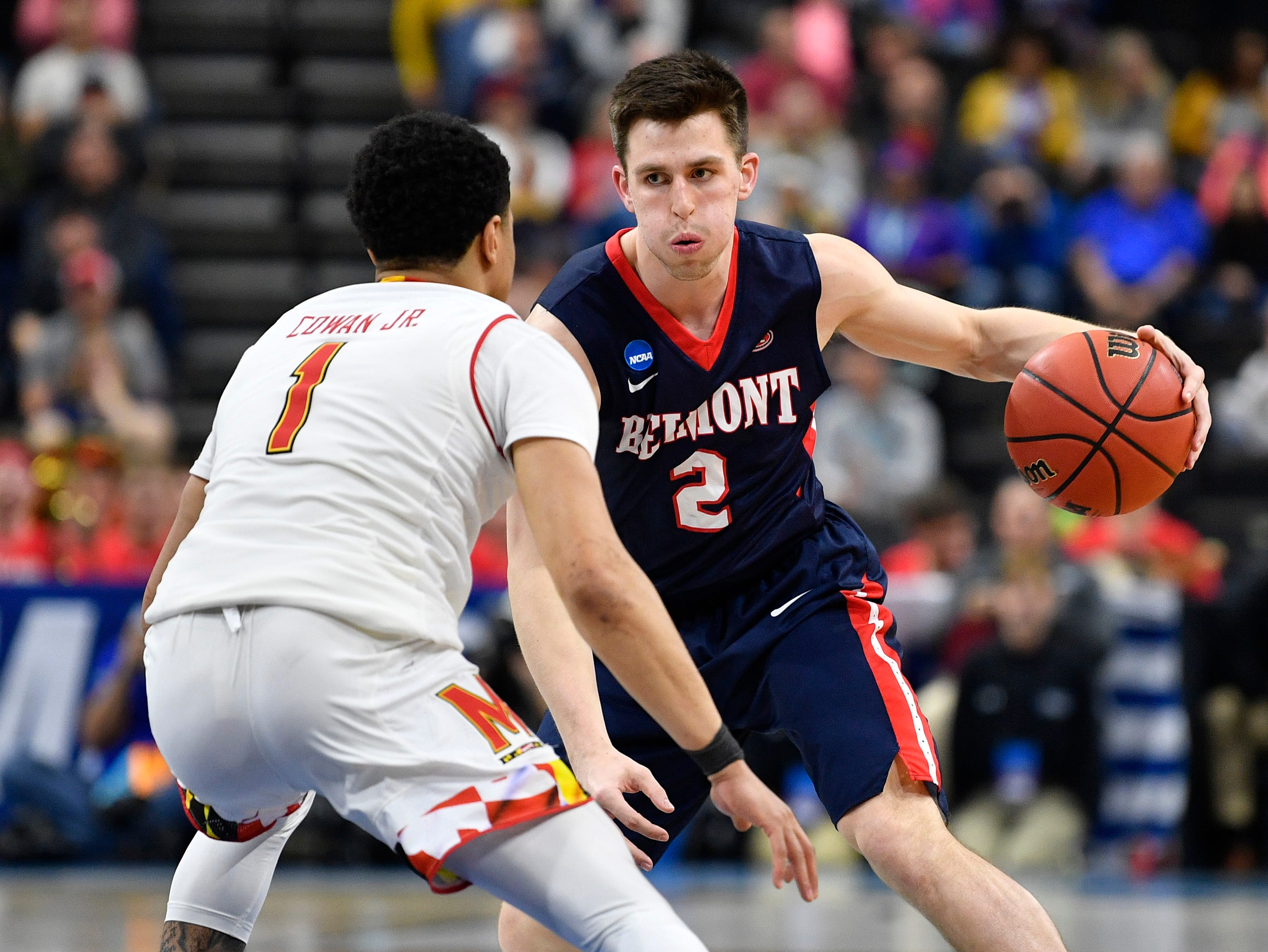 Belmont guard Grayson Murphy (2) looks for an opening past Maryland guard Anthony Cowan Jr. (1) during the second half of the first-round NCAA college basketball tournament game at VyStar Veterans Memorial Arena in Jacksonville, Fla., Thursday, March 21, 2019.