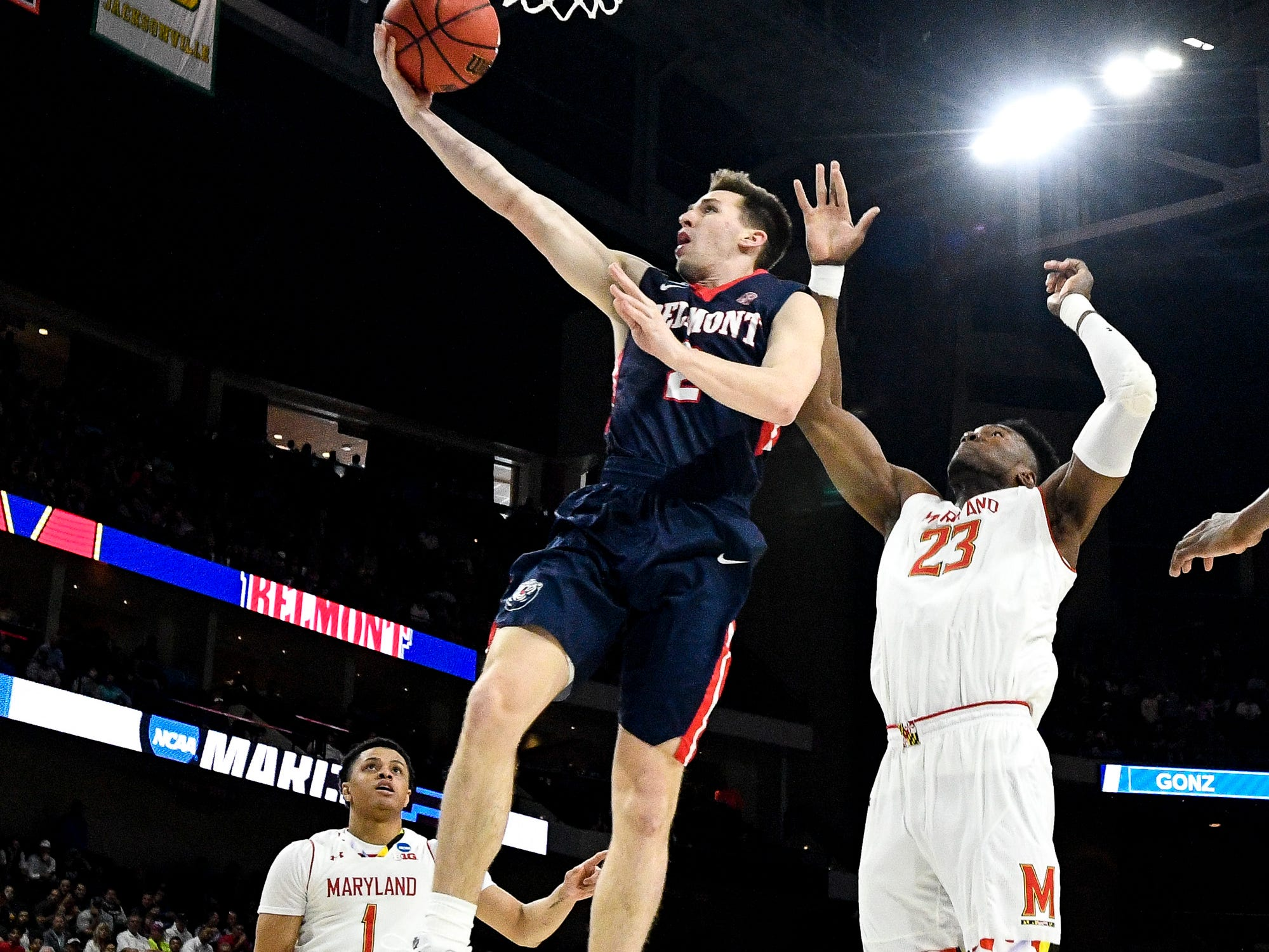Belmont guard Grayson Murphy (2) shoots past Maryland forward Bruno Fernando (23) during the first half of the first-round NCAA college basketball tournament game at VyStar Veterans Memorial Arena in Jacksonville, Fla., Thursday, March 21, 2019.