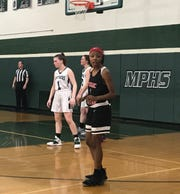 Passaic Charter sophomore Amaya Davidson checks with her coach during a stoppage in play. Midland Park defeated Passaic Charter, 58-30, in the North 1, Group 1 girls basketball tournament on Feb. 26, 2019.