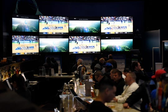 Sports fans bet and watch the first games of the NCAA basketball tournament in the FanDuel Sportsbook at the Meadowlands Racetrack on Thursday, March 21, 2019, in East Rutherford.