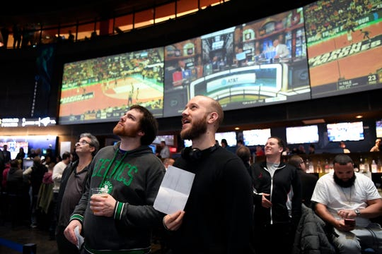 Dominick DeBonis, left, and Jake Frey travelled from Manhattan to place bets at the FanDuel Sportsbook in the Meadowlands Racetrack on Thursday, March 21, 2019 in East Rutherford. This is the first year sports fans can legally place bets during March Madness in New Jersey.