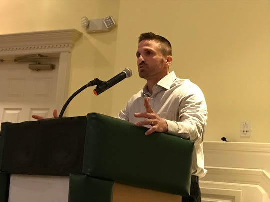 Rutherford football coach Andy Howell addresses the audience at Wednesday night's Coaches Symposium in Wyckoff.