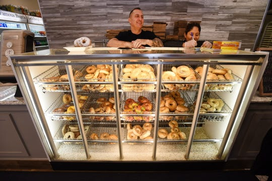 Ron Lamorgese(L), Assistant Manager and Erika Perez (R) behind a showcase of various bagels at Goldberg's Famous Bagels in Westwood on 01/17/19.