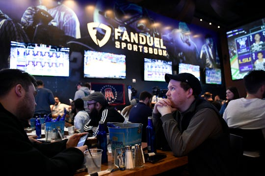 Seamus Magee, right, and Anthony Mea, both of Hoboken, watch the first games of the NCAA basketball tournament at the Meadowlands Racetrack, where sports fans can legally bet on March Madness games for the first time in New Jersey on Thursday, March 21, 2019, in East Rutherford.