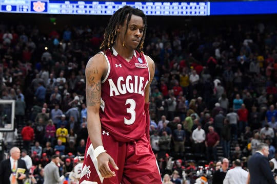 Mar 21, 2019; Salt Lake City, UT, USA; New Mexico State Aggies guard Terrell Brown (3) walks off the court after the game against the Auburn Tigers in the first round of the 2019 NCAA Tournament at Vivint Smart Home Arena. Mandatory Credit: Kirby Lee-USA TODAY Sports