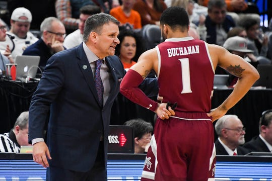 Mar 21, 2019; Salt Lake City, UT, USA; New Mexico State Aggies head coach Chris Jans speaks to guard Shunn Buchanan (1) during the second half in the first round of the 2019 NCAA Tournament against the Auburn Tigers at Vivint Smart Home Arena. Mandatory Credit: Kirby Lee-USA TODAY Sports