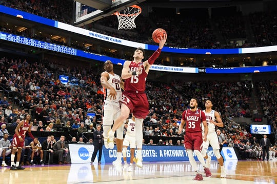 Mar 21, 2019; Salt Lake City, UT, USA; New Mexico State Aggies forward Ivan Aurrecoechea (15) goes up for a shot as Auburn Tigers forward Horace Spencer (0) defends during the second half in the first round of the 2019 NCAA Tournament at Vivint Smart Home Arena. Mandatory Credit: Kirby Lee-USA TODAY Sports