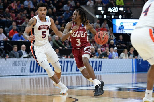 Mar 21, 2019; Salt Lake City, UT, USA; New Mexico State Aggies guard Terrell Brown (3) drives around Auburn Tigers forward Chuma Okeke (5) during the first half in the first round of the 2019 NCAA Tournament at Vivint Smart Home Arena. Mandatory Credit: Gary A. Vasquez-USA TODAY Sports