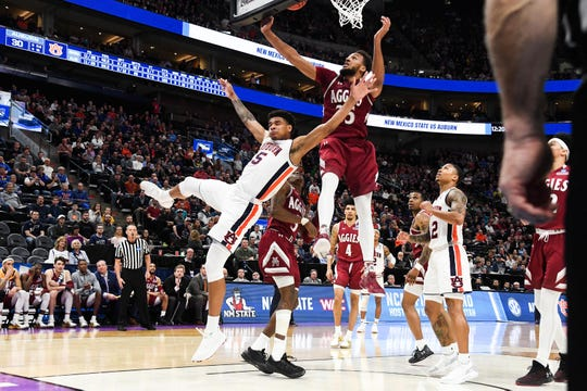 Mar 21, 2019; Salt Lake City, UT, USA; Auburn Tigers forward Chuma Okeke (5) and New Mexico State Aggies forward Johnny McCants (35) react as the ball goes loose during the first half in the first round of the 2019 NCAA Tournament at Vivint Smart Home Arena. Mandatory Credit: Kirby Lee-USA TODAY Sports