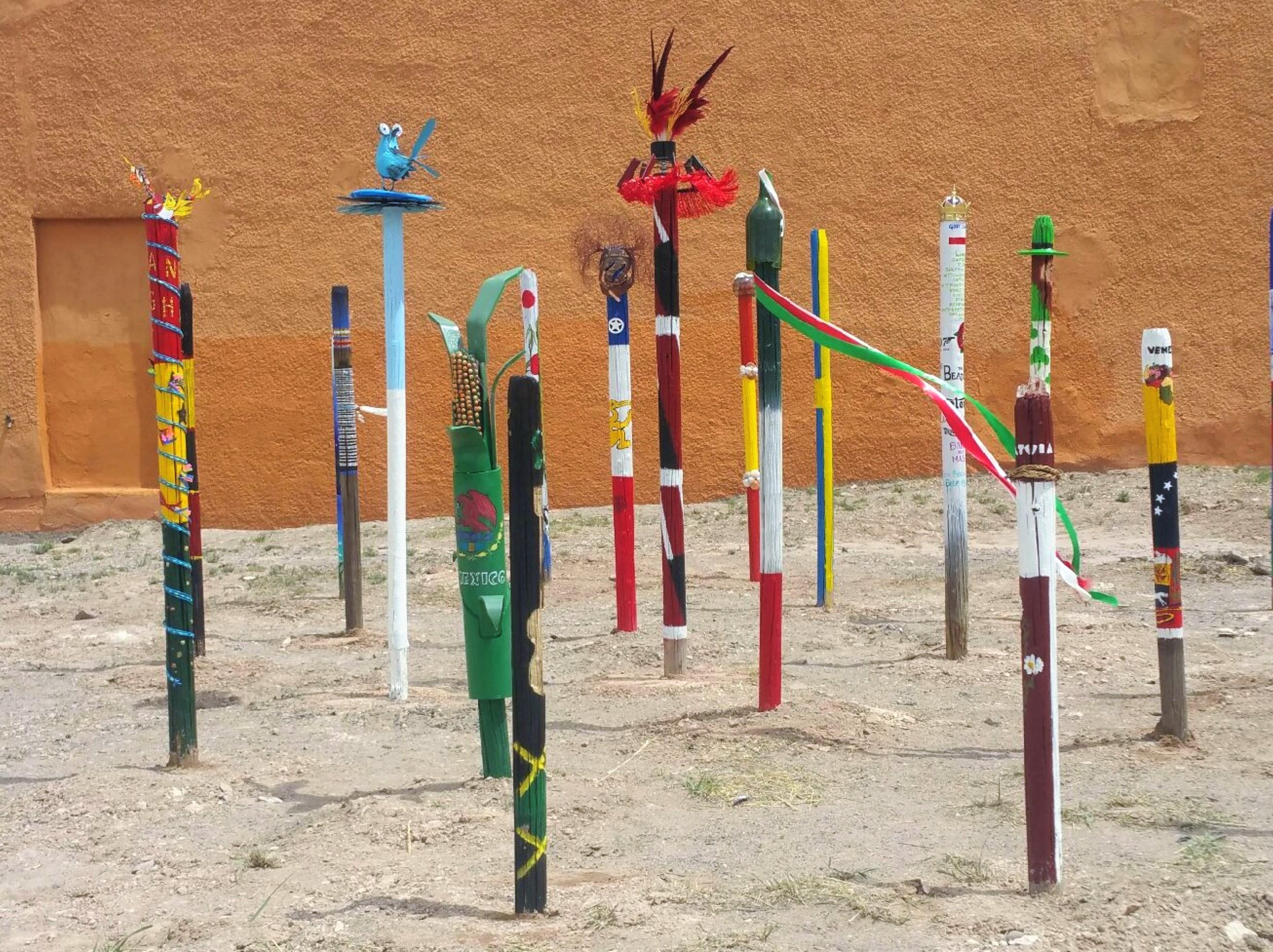 Artists from Carrizozo planted poles last year, celebrating World Art Day. The art represents different countries.