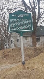 This historic marker, on Power Road just north of Alameda, reveals the approximate location of Arthur Power's first settlement in Farmington. The original log cabins are long gone and replaced by private homes.