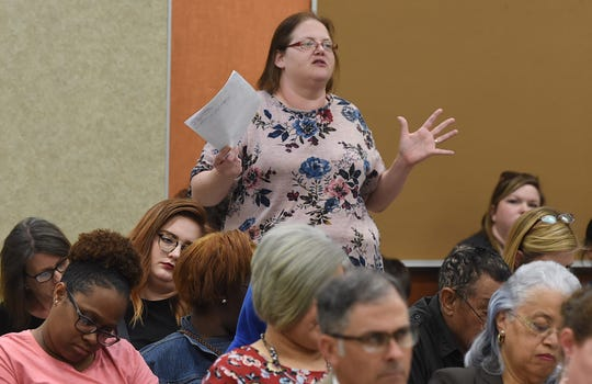Parent Suzanne Pitre speaks at the school board meeting Wednesday. The council voted on a plan that would shut down two elementary schools.