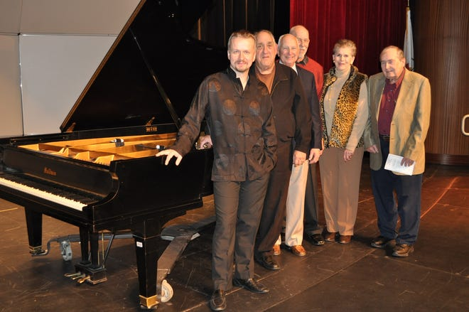 From left: Virtuoso pianist Ilya Yakushev is joined onstage by Palm Springs Concerts' First VP Ken LaConde, President Christopher Seidel, Past President John Leonard, Second VP Eula Harris and Third VP James Berry.