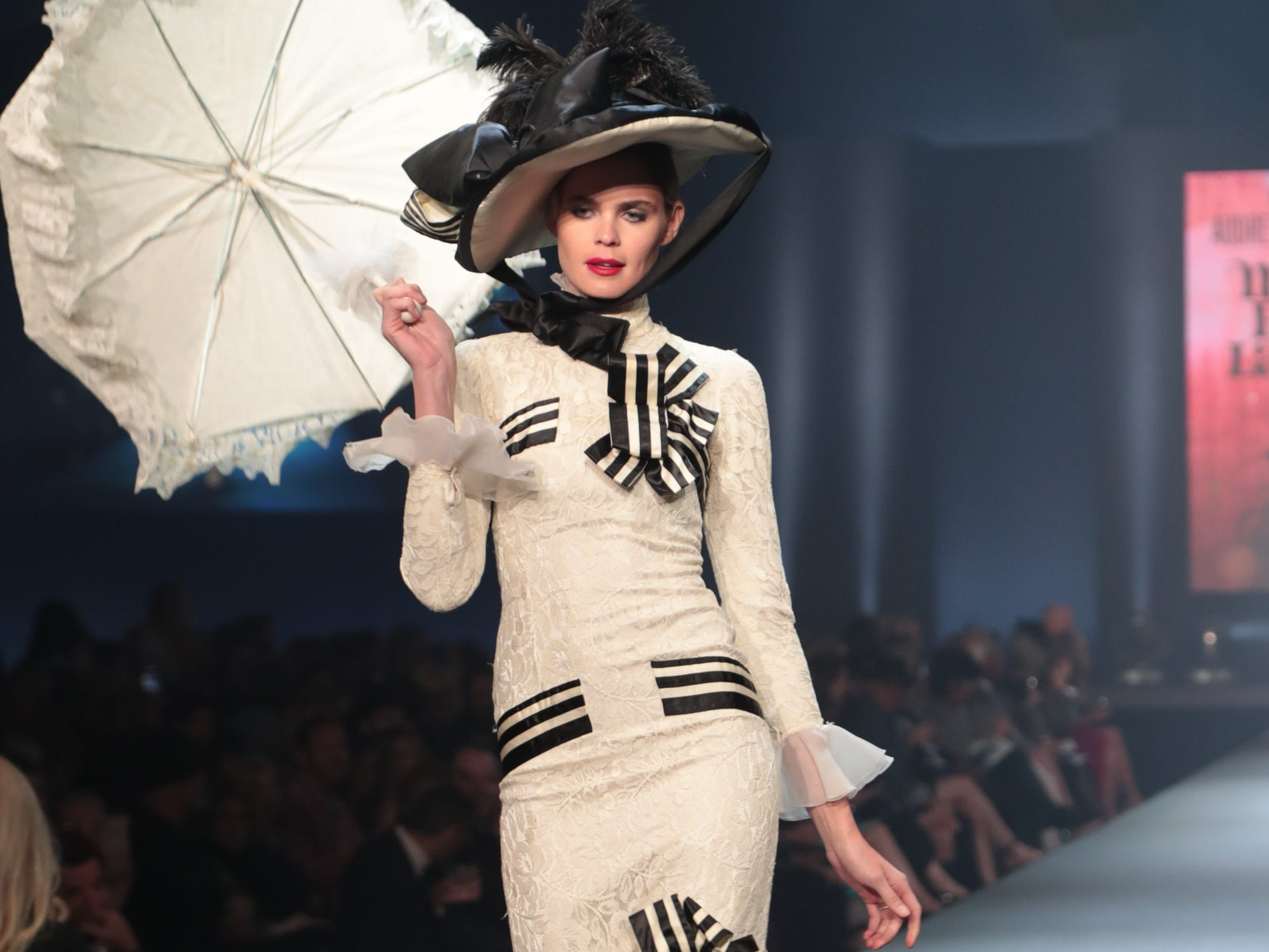 "A model wears Audrey Hepburn's dress from My Fair Lady in the ""Hollywood Party -- No One Sleeps Tonight"" show at Fashion Week El Paseo, Palm Desert, Calif., March 20, 2019."