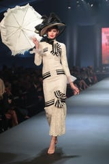 "A model wears Audrey Hepburn's dress from My Fair Lady in the ""Hollywood Party -- No One Sleeps Tonight"" show at Fashion Week El Paseo, Palm Desert, Calif., March 20, 2019. The Palm Desert City Council is weighing a proposal to allow four-story buildings in certain areas of the high-end shopping district to allow for mixed-use development that combines dining, shopping and lodging."